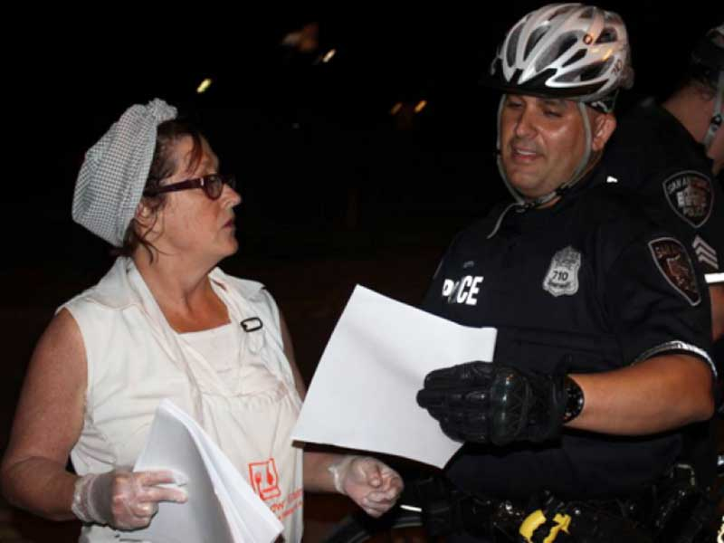 Joan Cheever and a cop.
