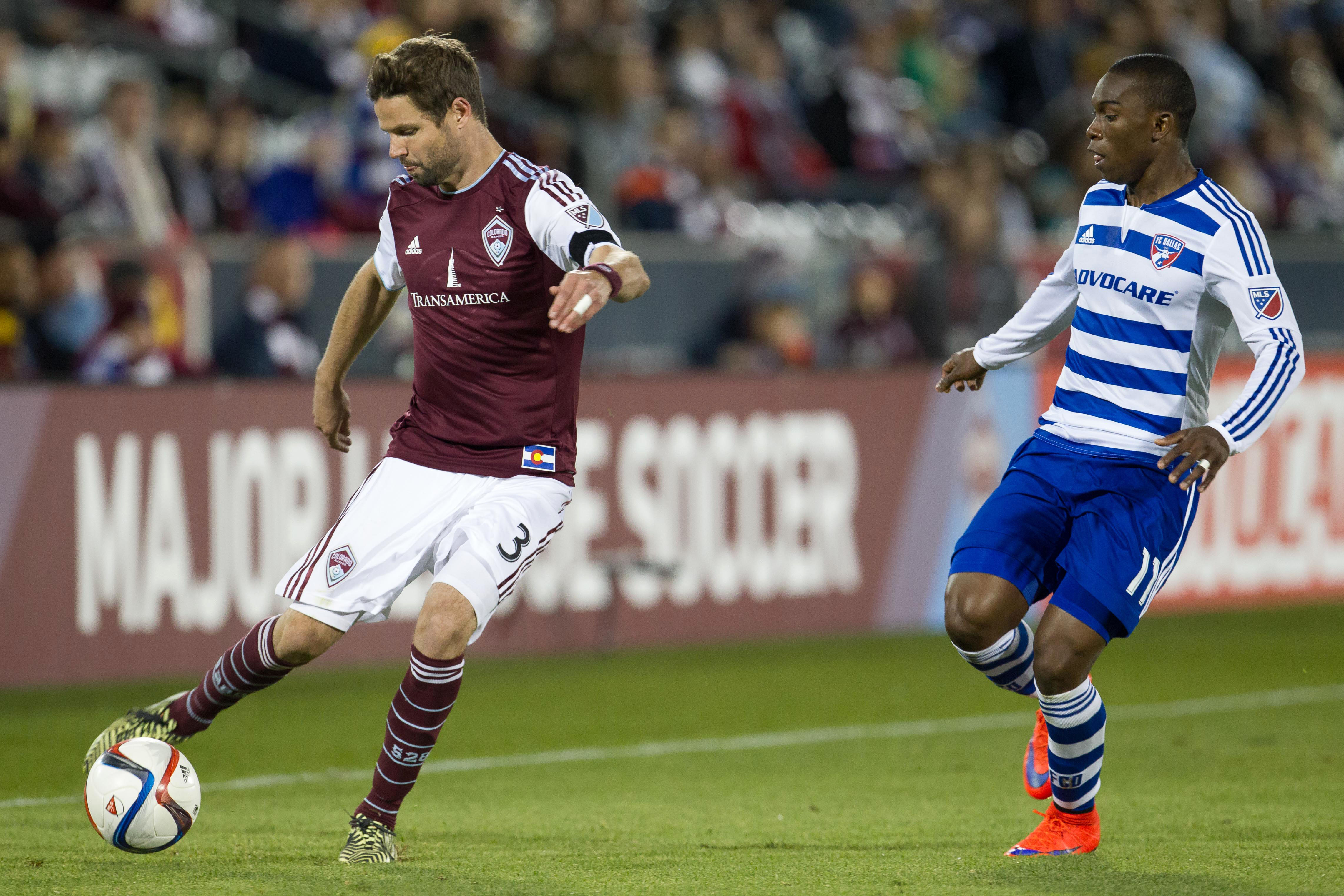 Drew Moor beating Fabian Castillo to the ball in the second half of the Rapids match vs FC Dallas