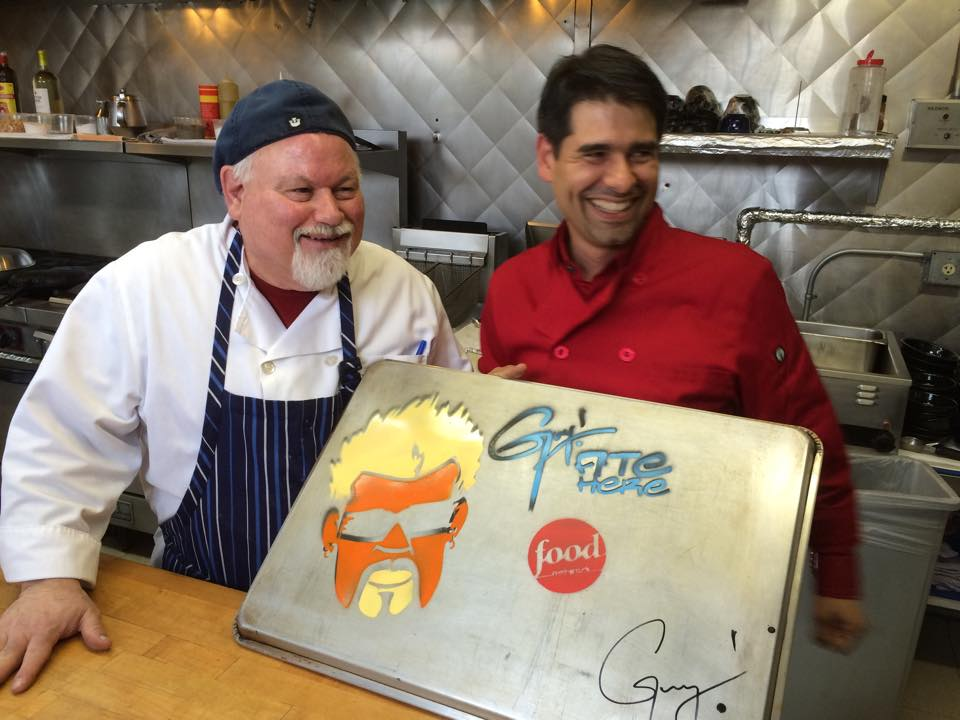 Owners Tony & Maurcido with the signed sheet pan.