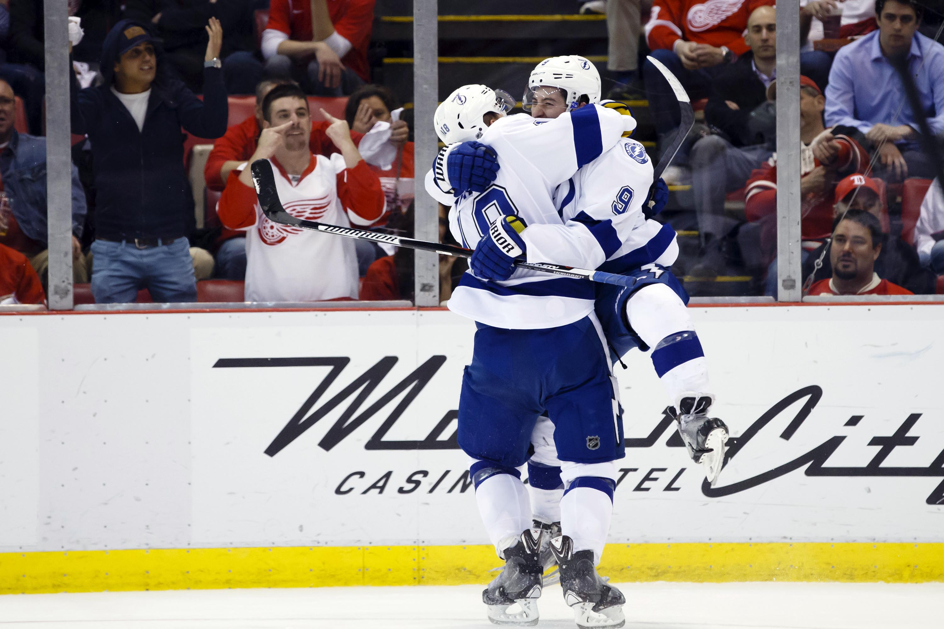 """Post-season goal scoring leader Tyler Johnson (5'9"""") leaps like a child into the arms of a lower scoring, taller teammate"""