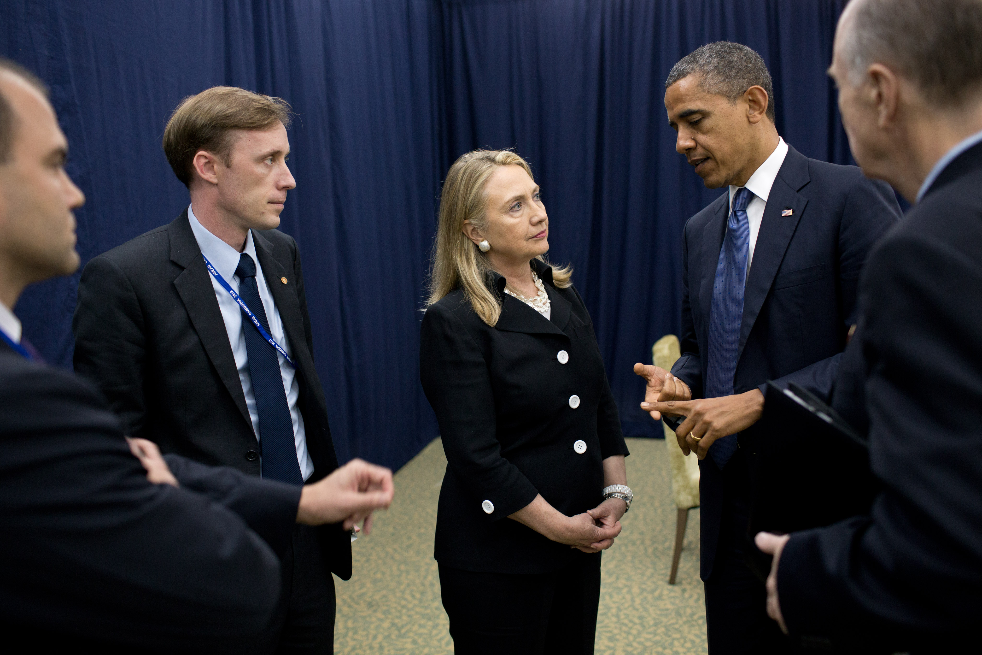 Jake Sullivan listens as President Barack Obama talks with Secretary of State Hillary Clinton in Cambodia about his decision to dispatch her to help broker a cease-fire in the Middle East in November 2012