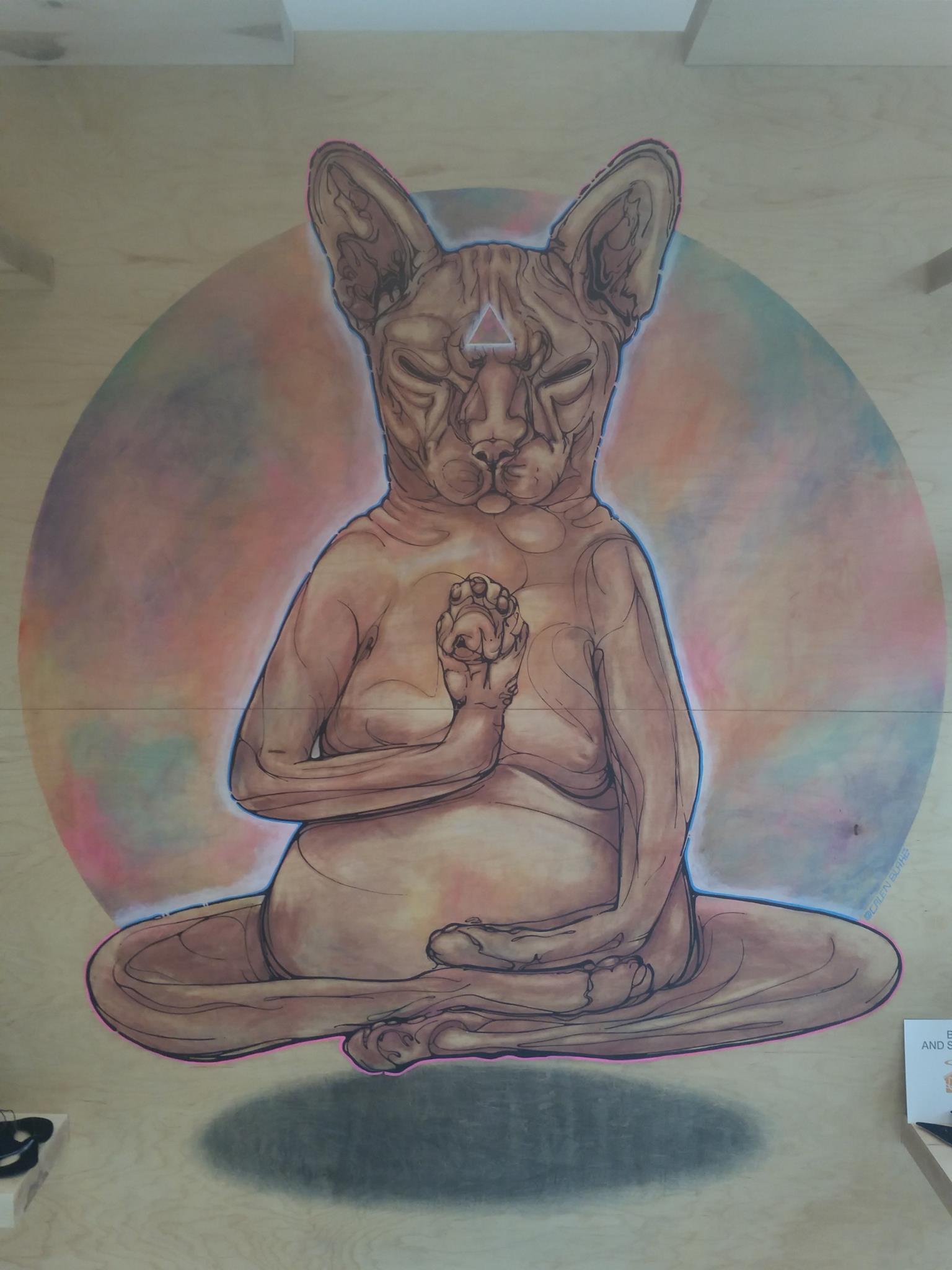 Meditating cat mural at KitTea