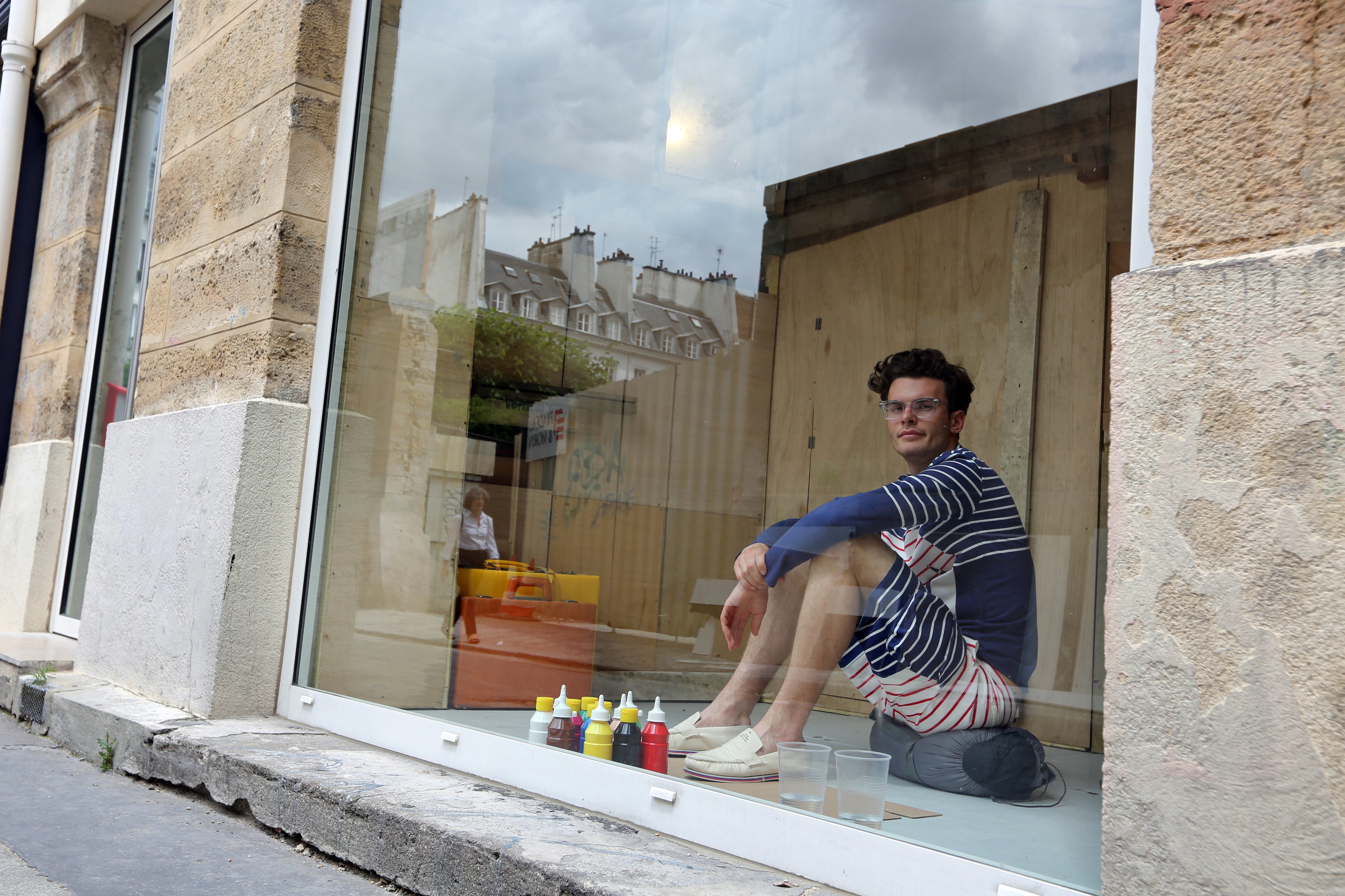 A model performs as part of Band of Outsiders' 60-hour Paris Fashion Week presentation, spring 2013. Photo: Getty.