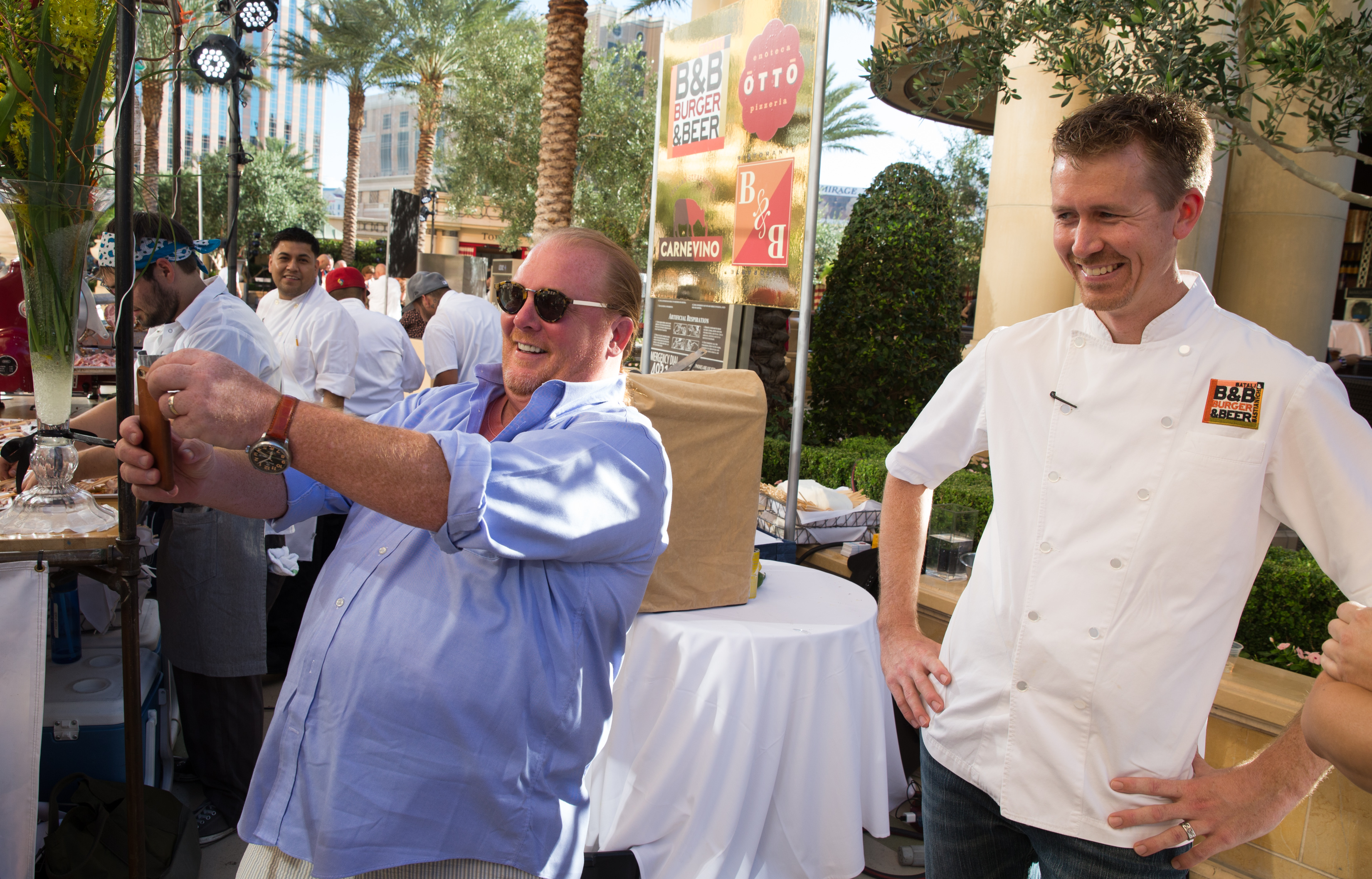 Chef Mario Batali takes a selfie with chef Jason Neve from the B&B empire at the Carnival of Cuisine.