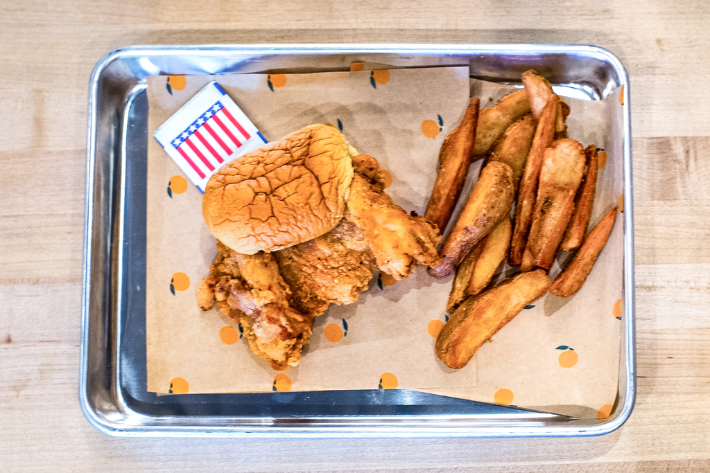 Fried chicken sandwich and fries at Fuku.