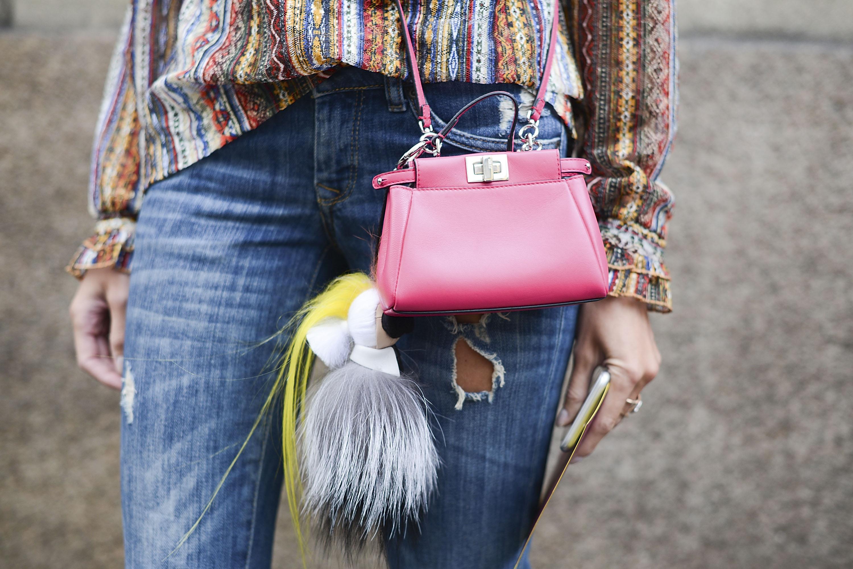 A Fendi bag and Karlito pom in Milan.