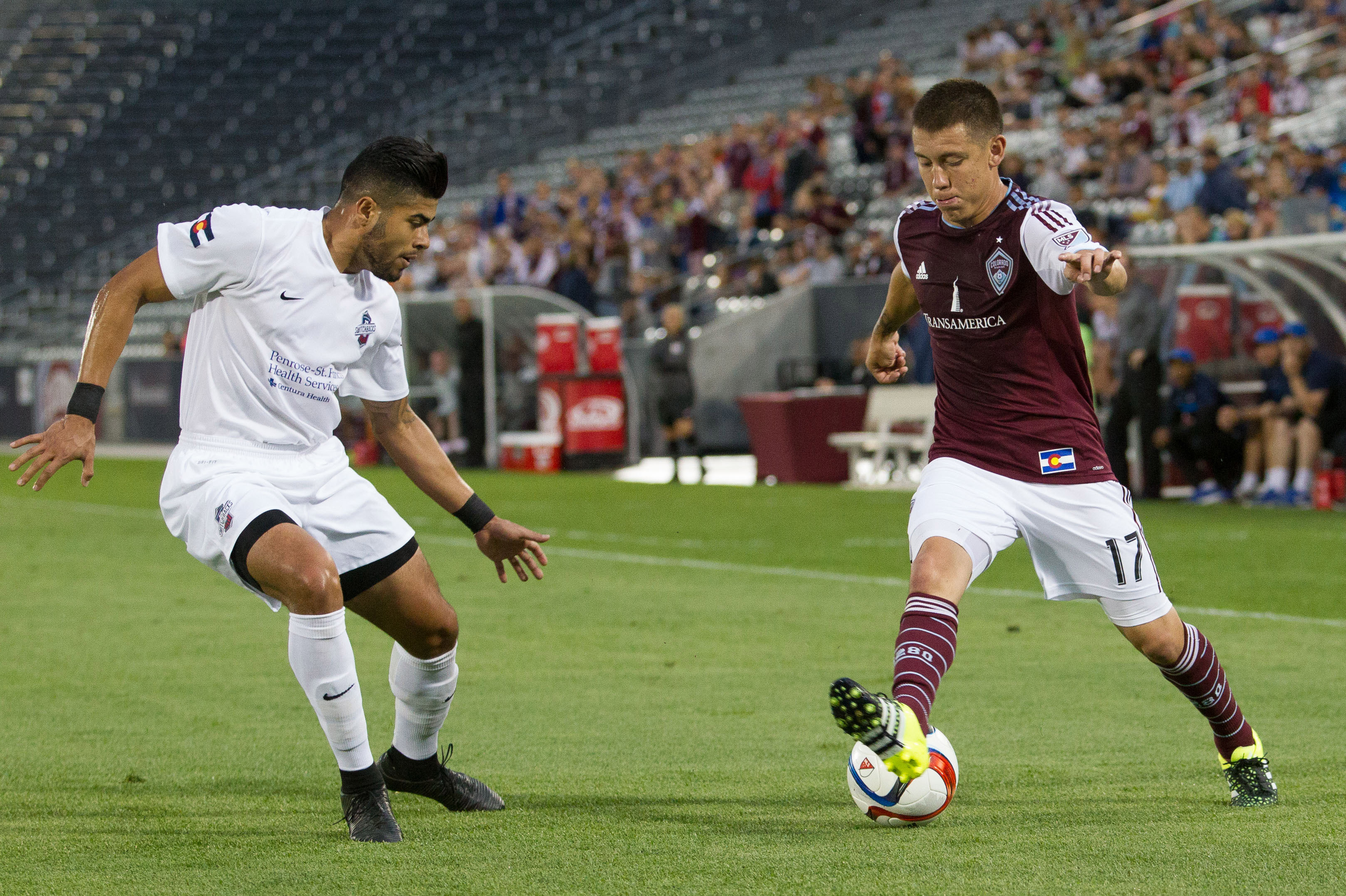 Colorado Rapids midfielder Dillon Serna (17) dribbles the ball against Switchbacks FC midfielder Rony Argueta (8) in the first half at Dick's Sporting Goods Park.
