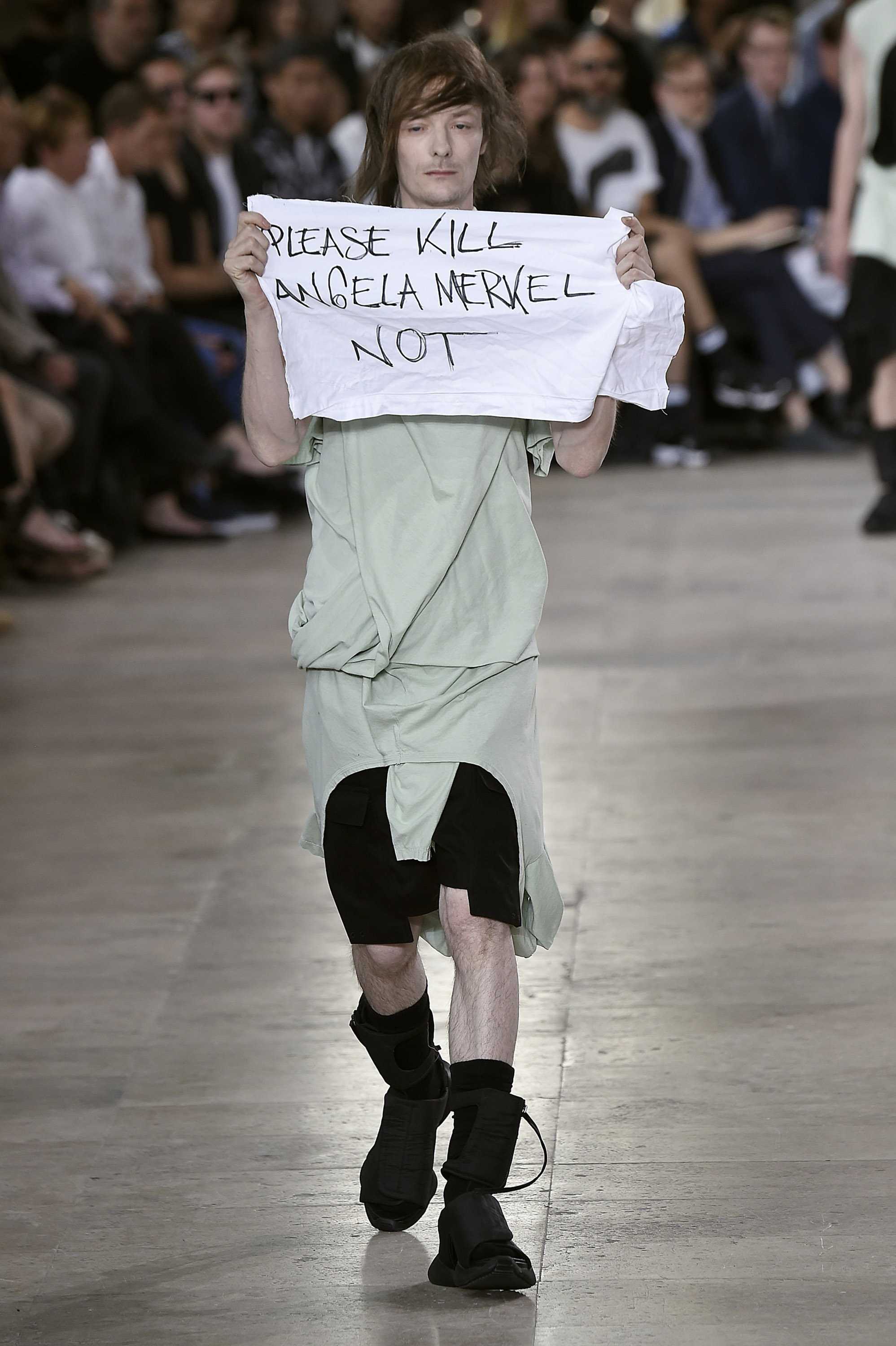 92b4962c94e8 Rick Owens Says He Punched a Model Who Carried a Protest Banner on the  Runway.