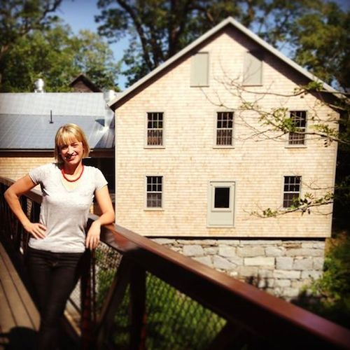 The Lost Kitchen chef/owner Erin French in front of The Mill at Freedom Falls.