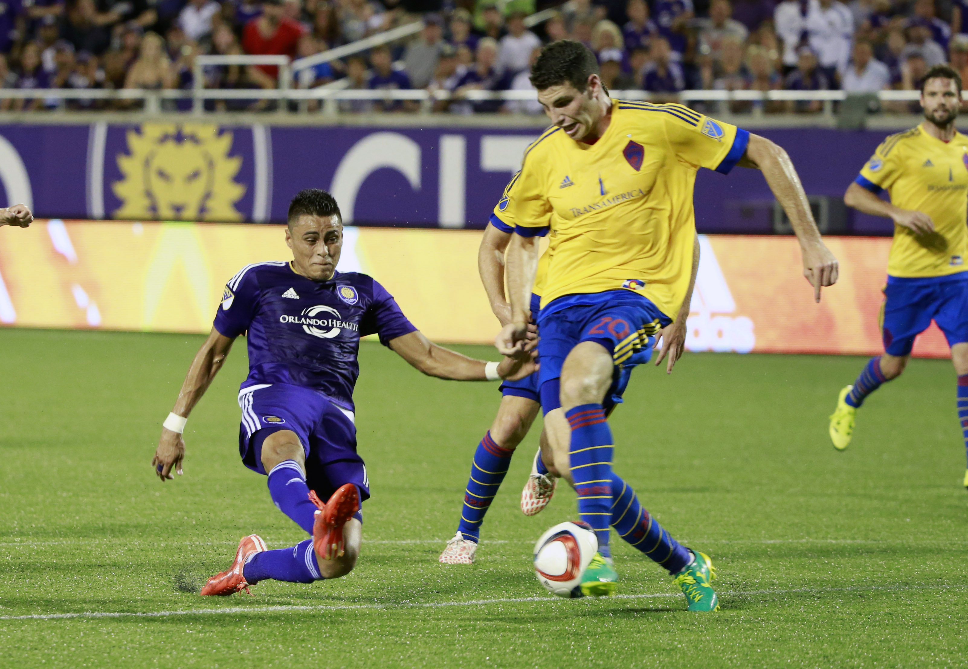 Josephy Greenspan making a challenge in the box and winning possession of the ball.