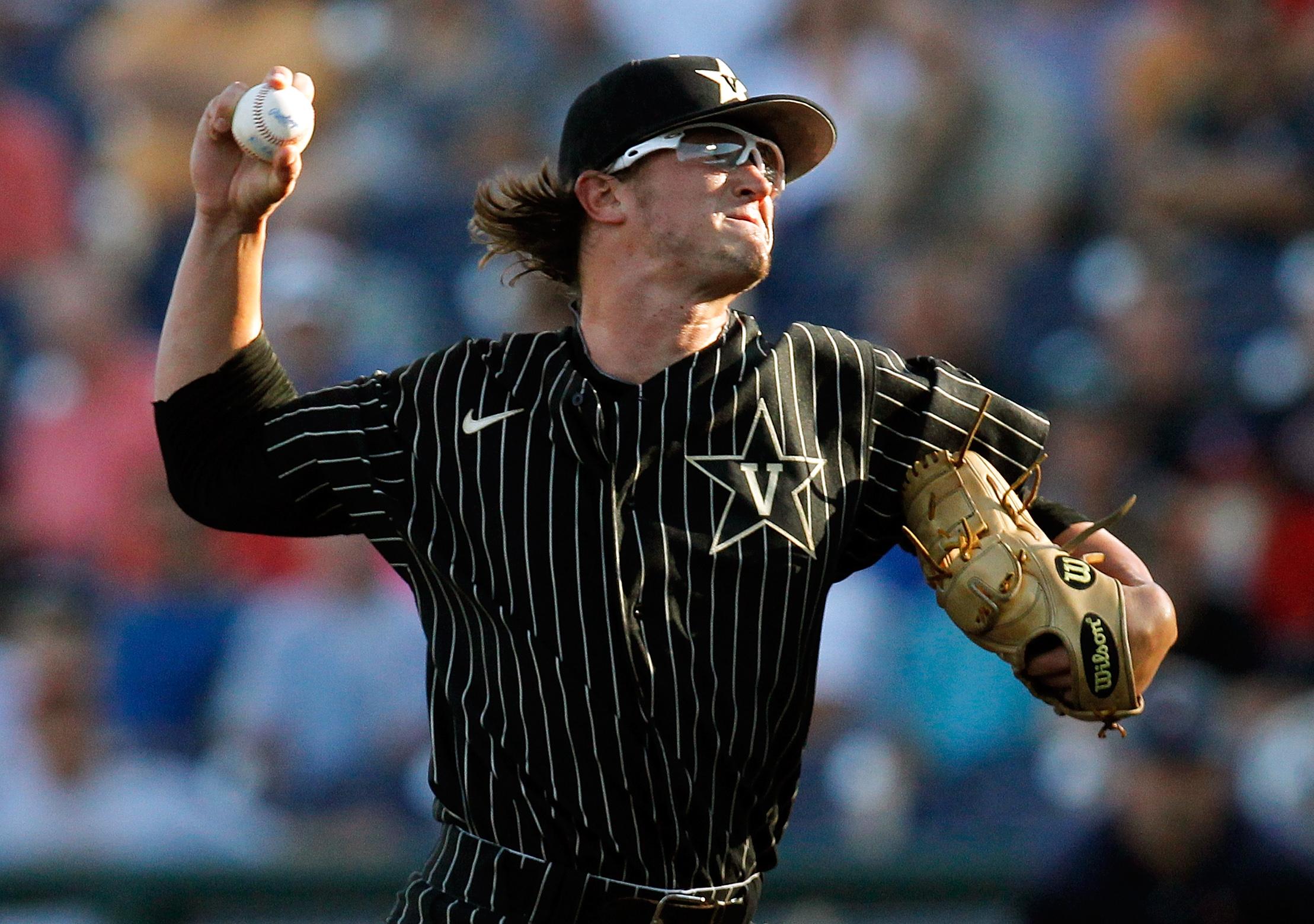 Carson Fulmer, softly tossing a few warm-up throws...