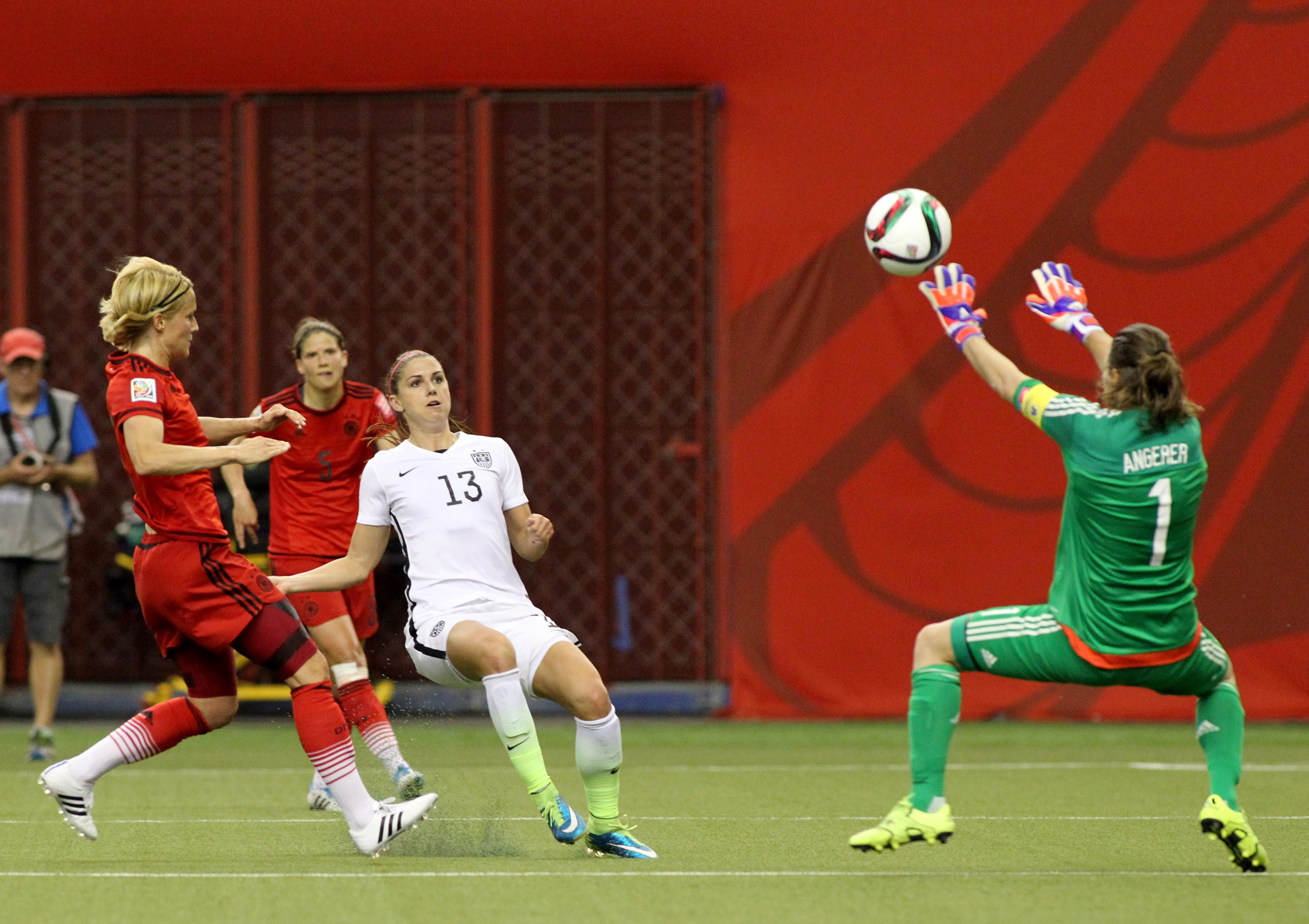 Nadine Angerer makes a save on Thorns teammate Alex Morgan during the World Cup Semifinal on June 30.