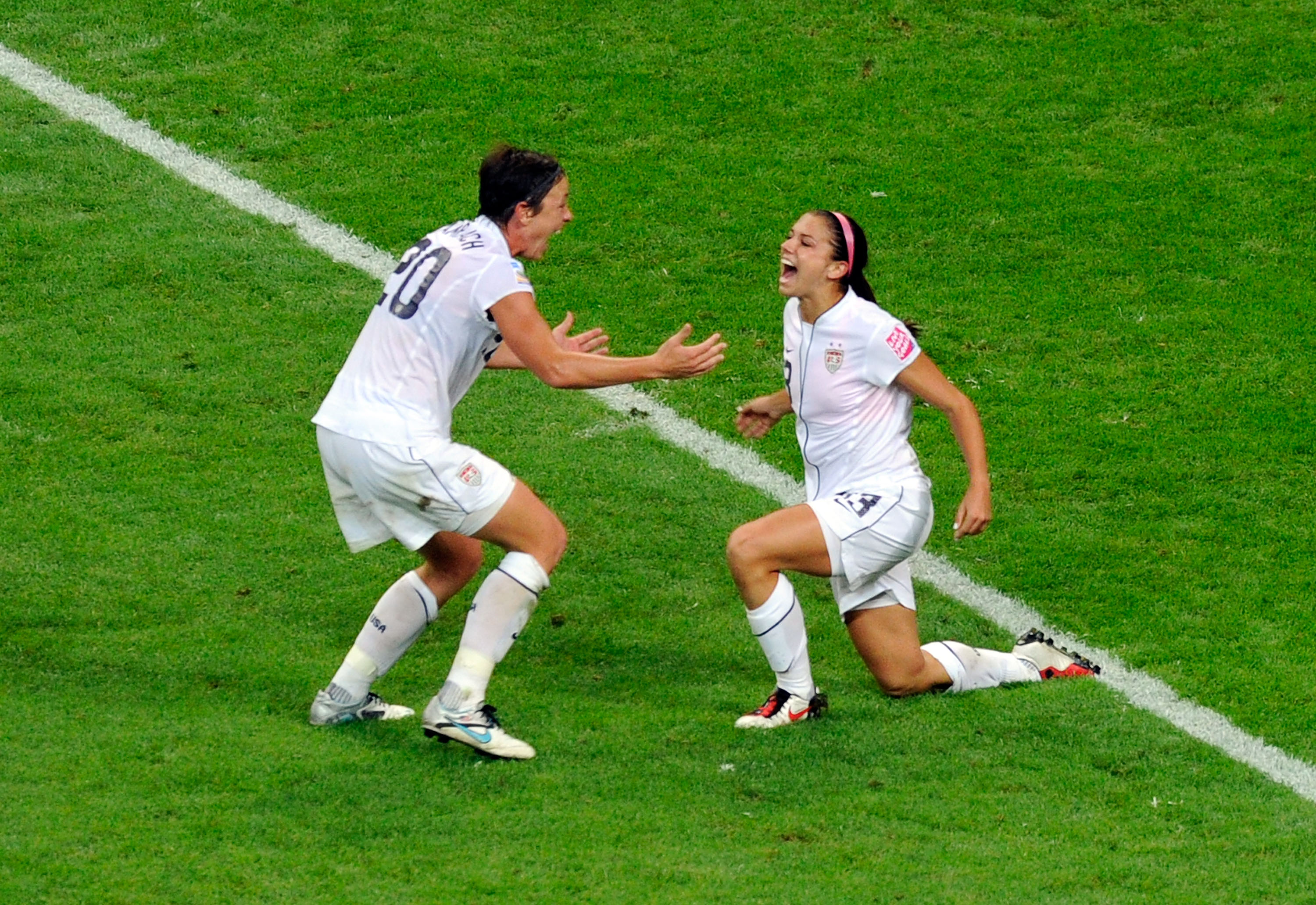 Alex Morgan and Abby Wambach celebrate in the 2011 World Cup final after going up against Japan in extra time.
