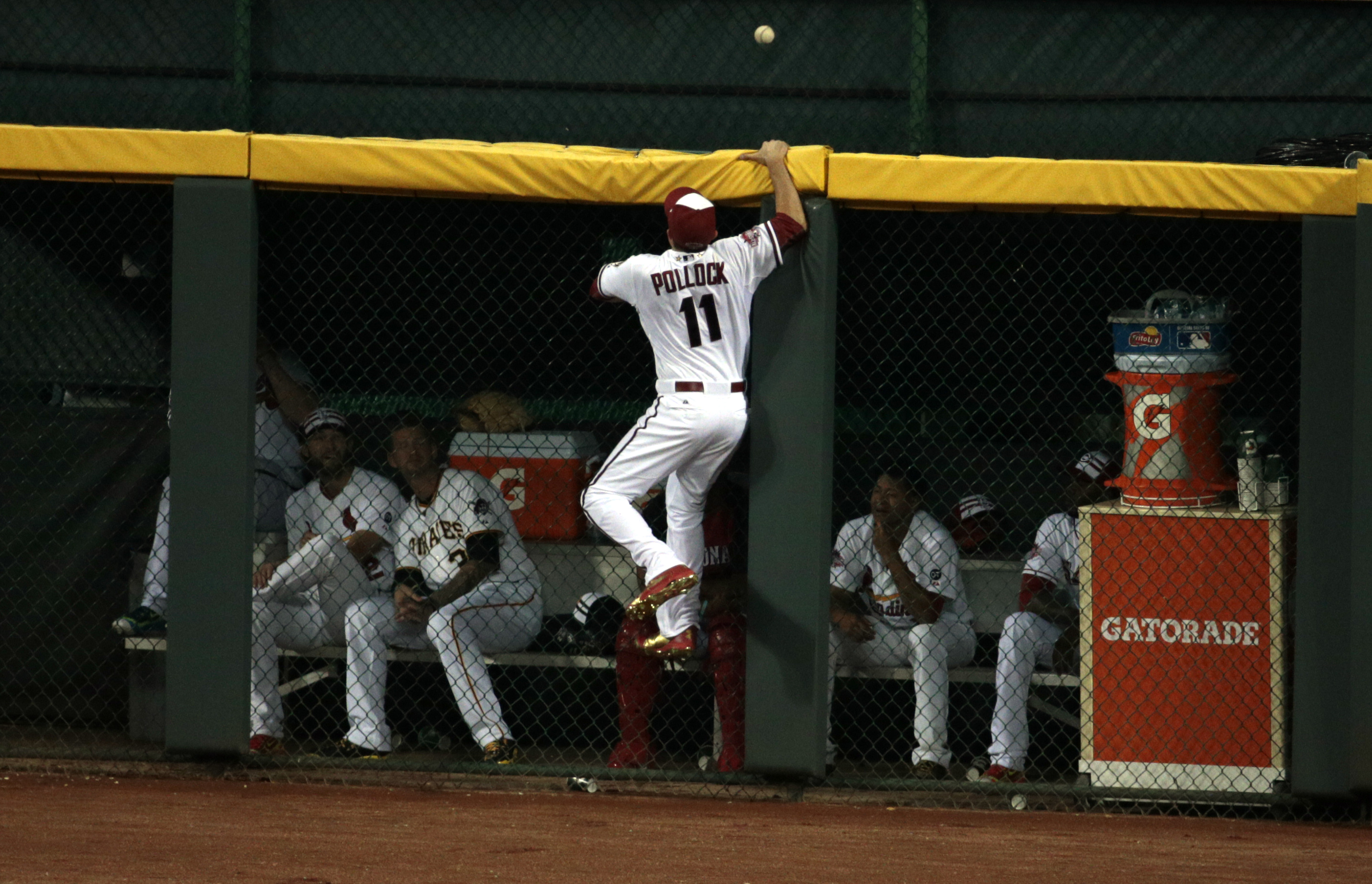National League outfielder A.J. Pollock of the Arizona Diamondbacks cannot get to a home run hit by American League second baseman Brian Dozier of the Minnesota Twins during the eighth inning of the 2015 MLB All Star Game at Great American Ball Park.