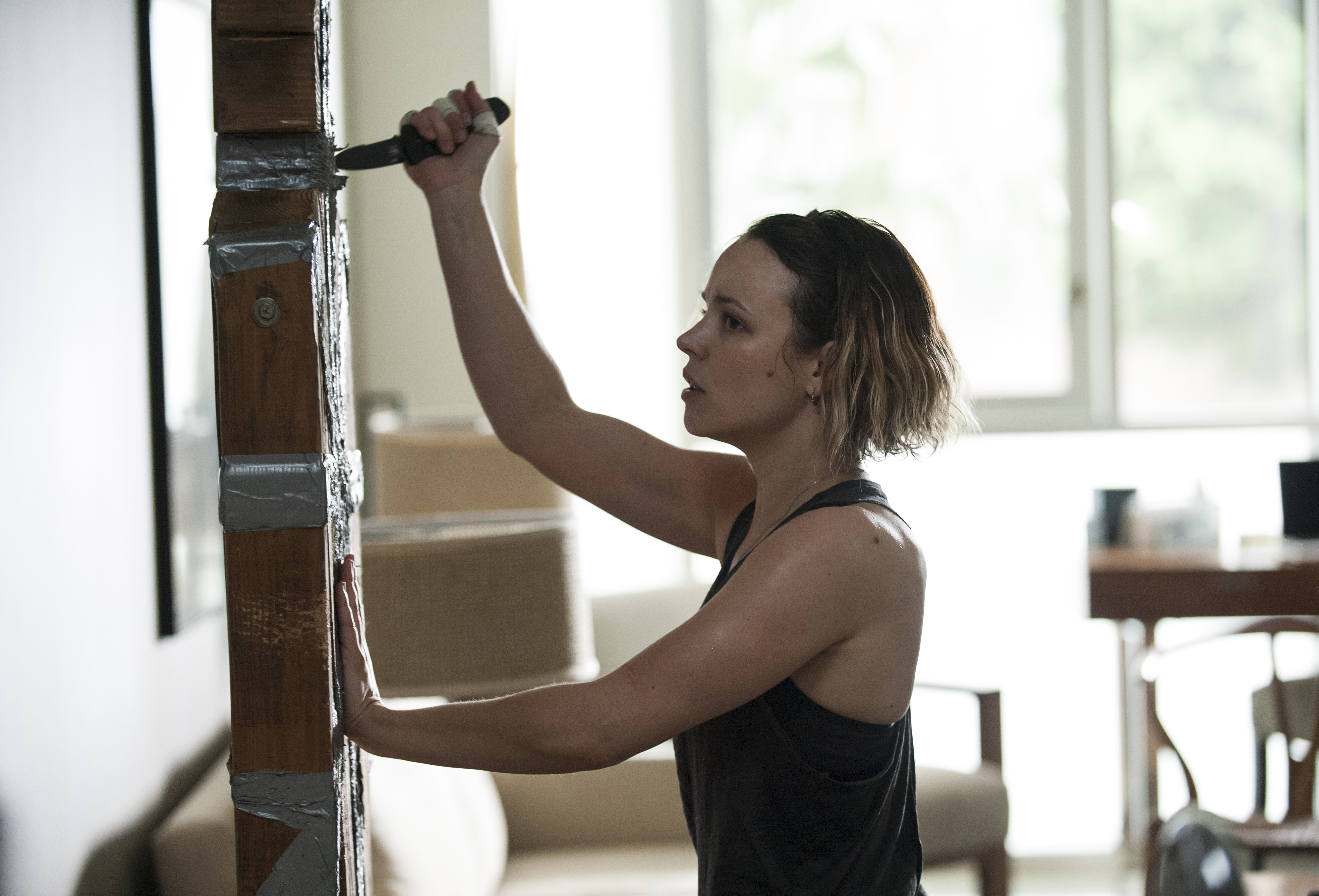 Ani (Rachel McAdams) works on her knife technique before going undercover.