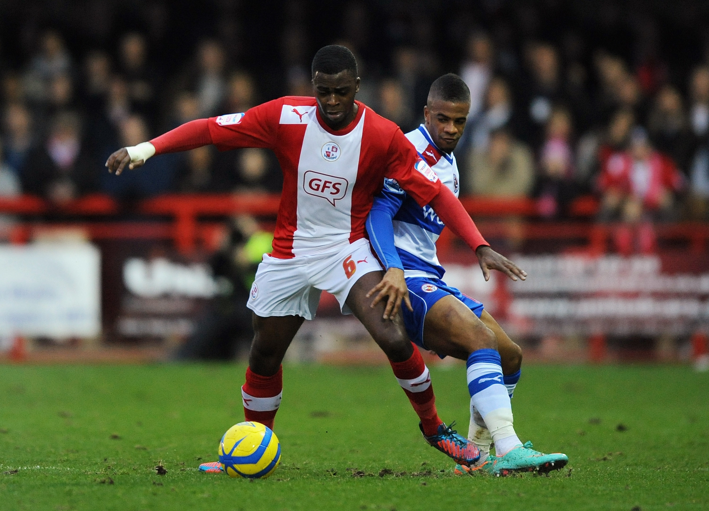 Hope Akpan battles against Garath McCleary for Crawley Town in 2013.