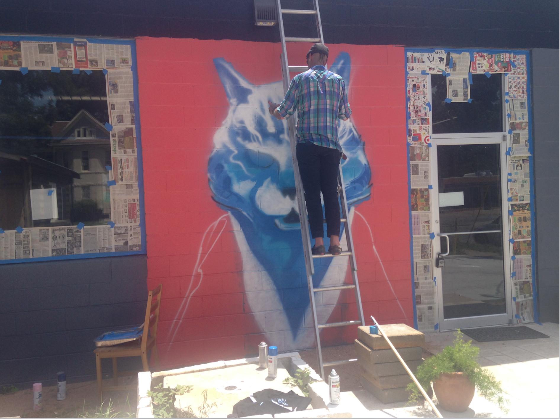 Blue Cat Cafe's mural in progress
