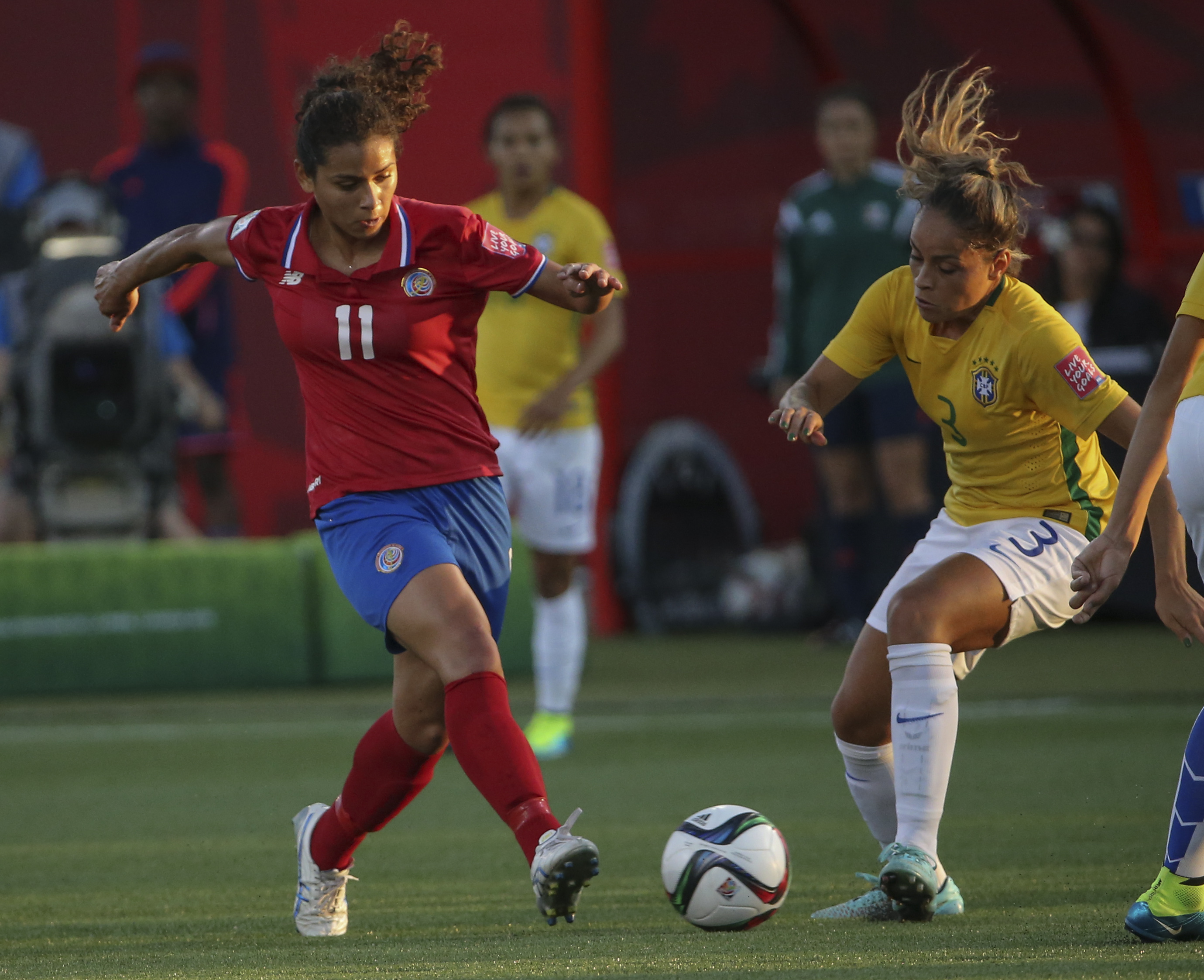 """Costa Rica and Penn State attacker Raquel """"Rocky"""" Rodriguez plays a pass against Brazil in the 2015 Women's World Cup."""