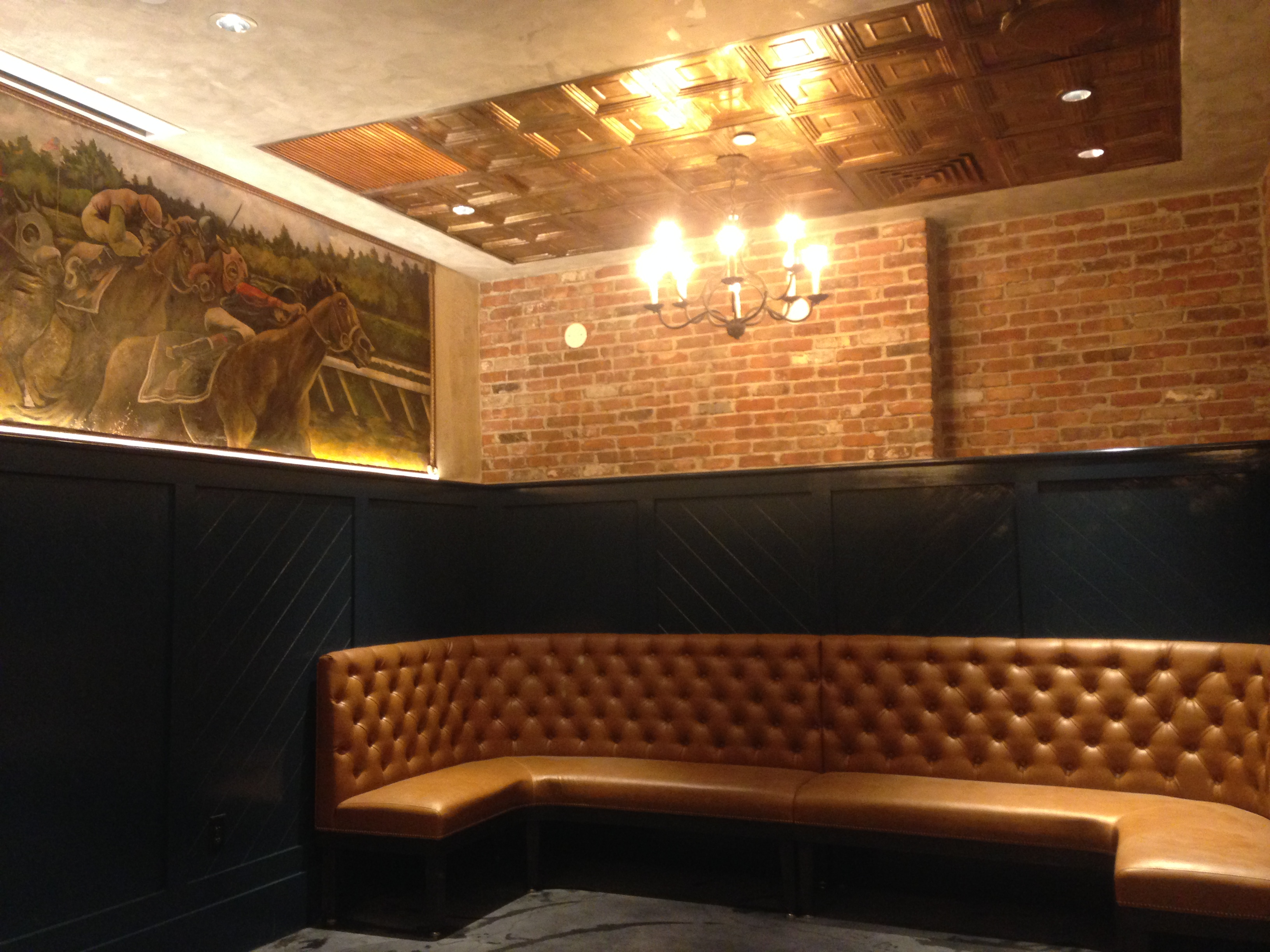 The private dining room at Worden Hall features a mural of the Saratoga race track by Mark Grundig