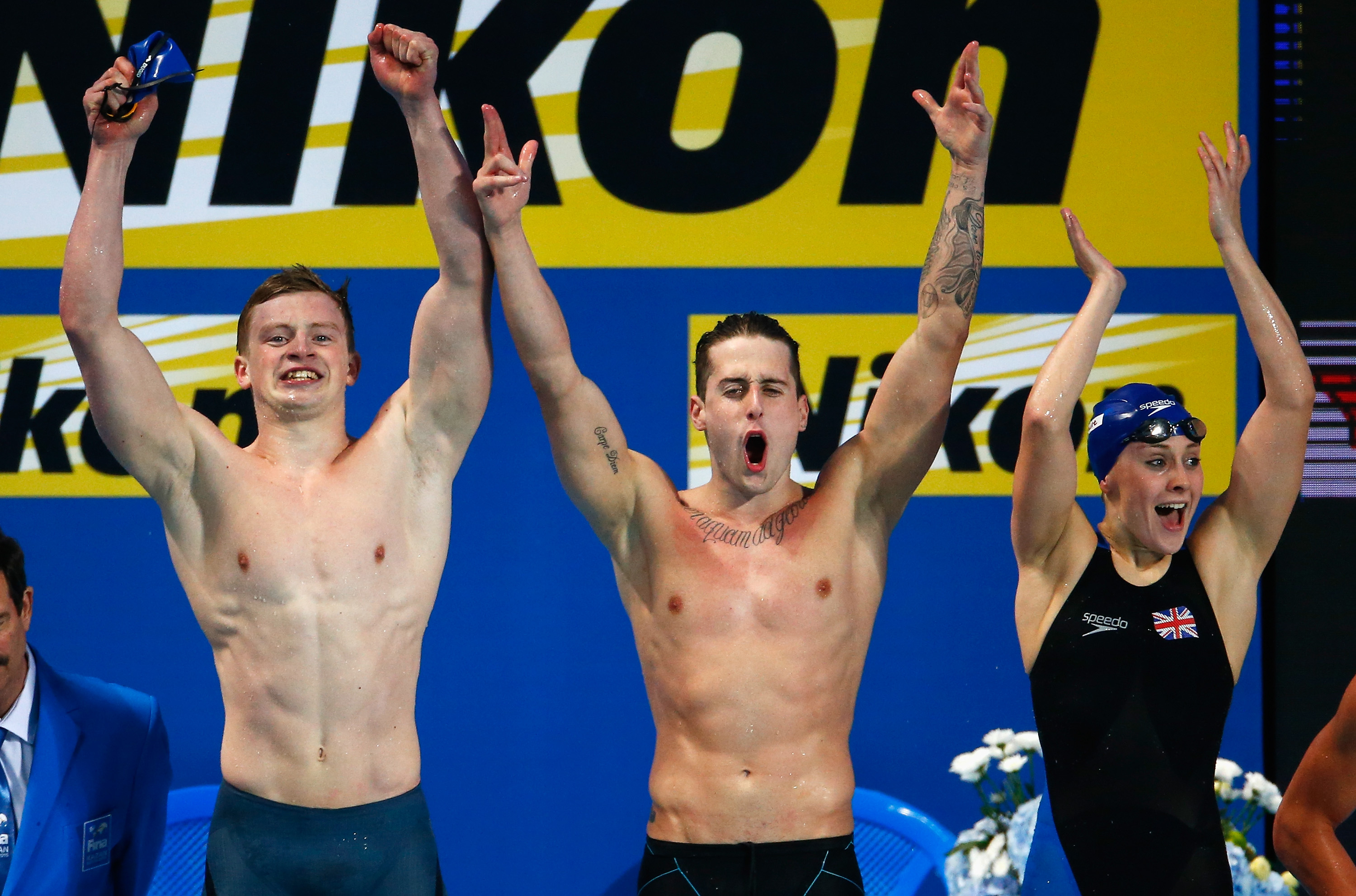 Adam Peaty, Chris Walker-Hebborn and Siobhan-Marie O'Connor of Great Britain celebrate winning gold in a new world record of 3:41.71 in the Mixed 4x100m Medley Relay Final on day twelve of the 16th FINA World Championships at the Kazan Arena.