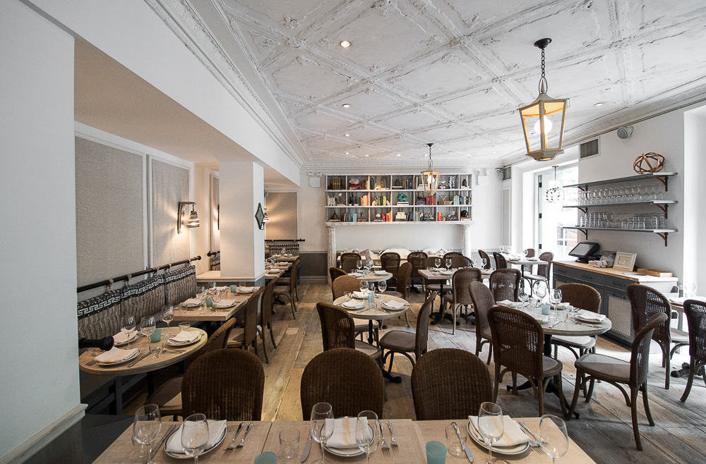 """[Claudette in Greenwich Village. If you look up """"summery"""" in the dictionary, there's a picture of this restaurant, similar to this one.  More rosé is consumed between these four walls than anywhere else in the Tri-State area.]"""