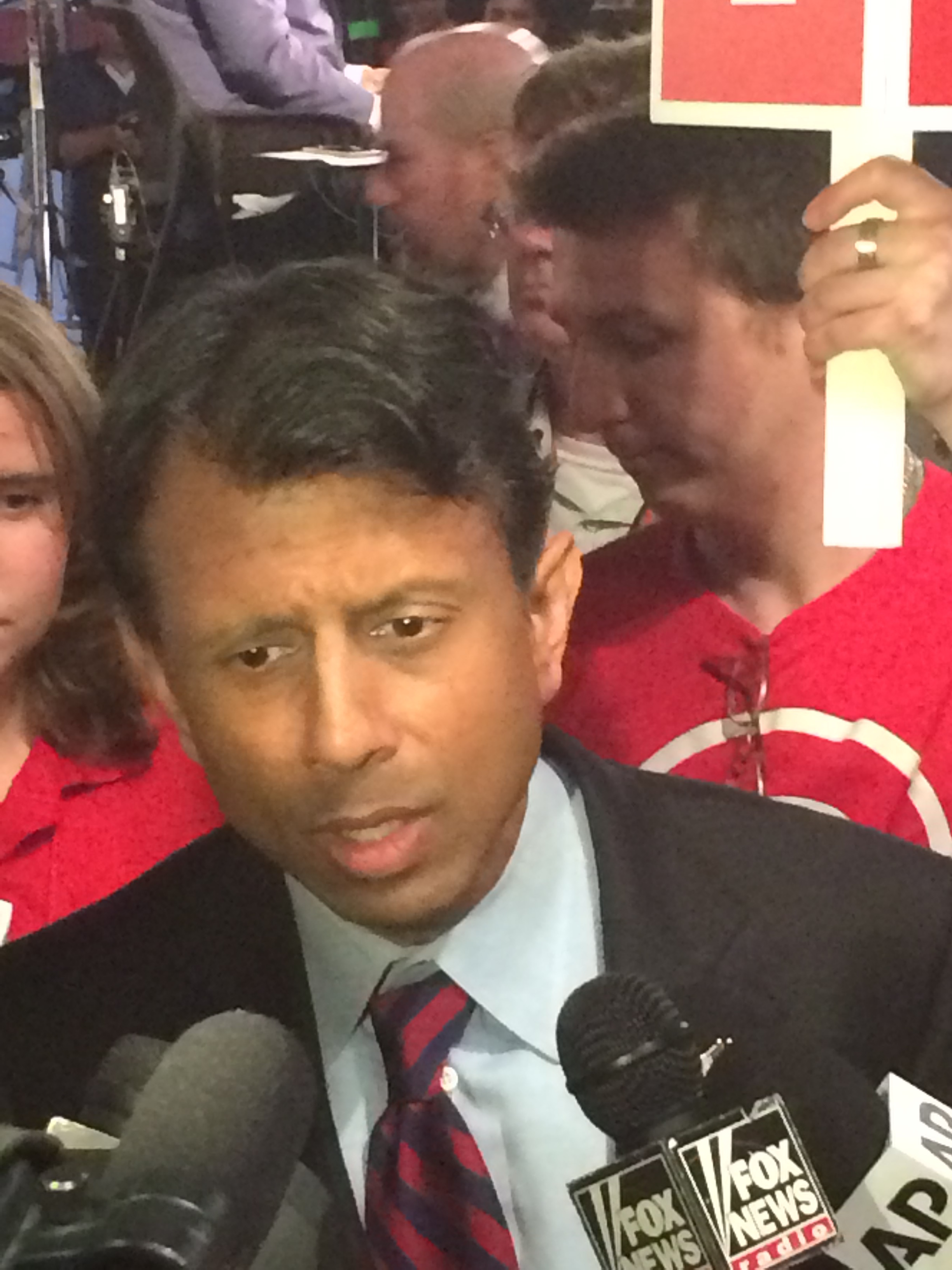 Bobby Jindal talks to reporters in the spin room Thursday.