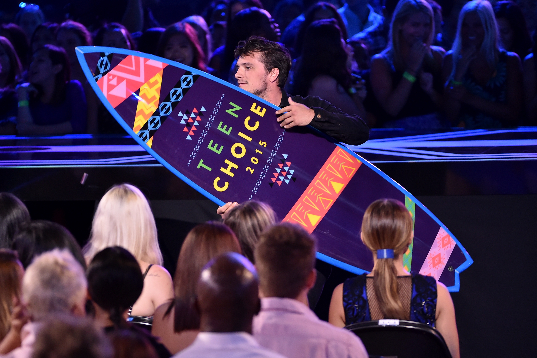 Josh Hutcherson accepts his surfboard for Actor in a Sci-Fi Role