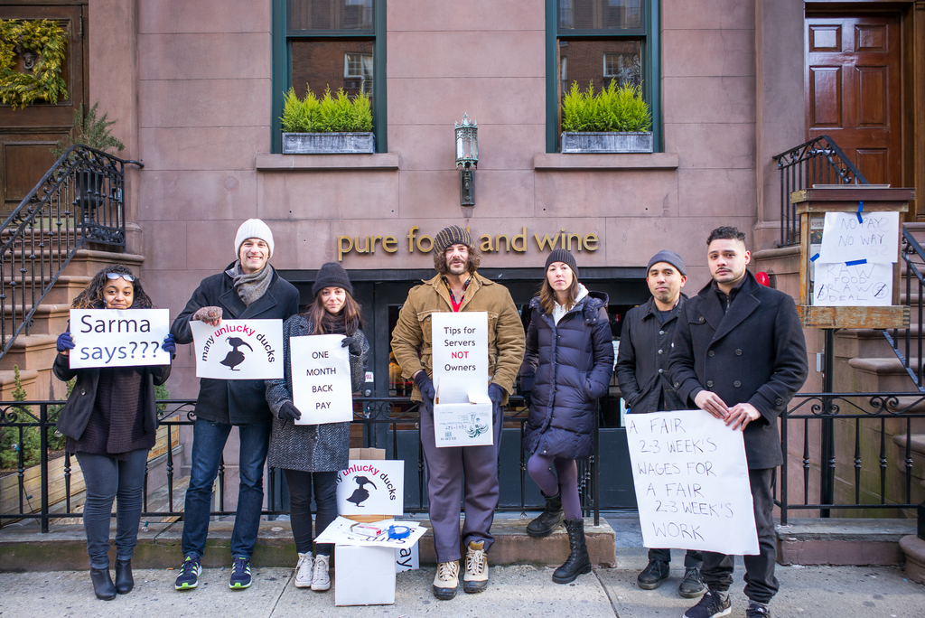 Workers protesting Pure Food & Wine earlier this year.