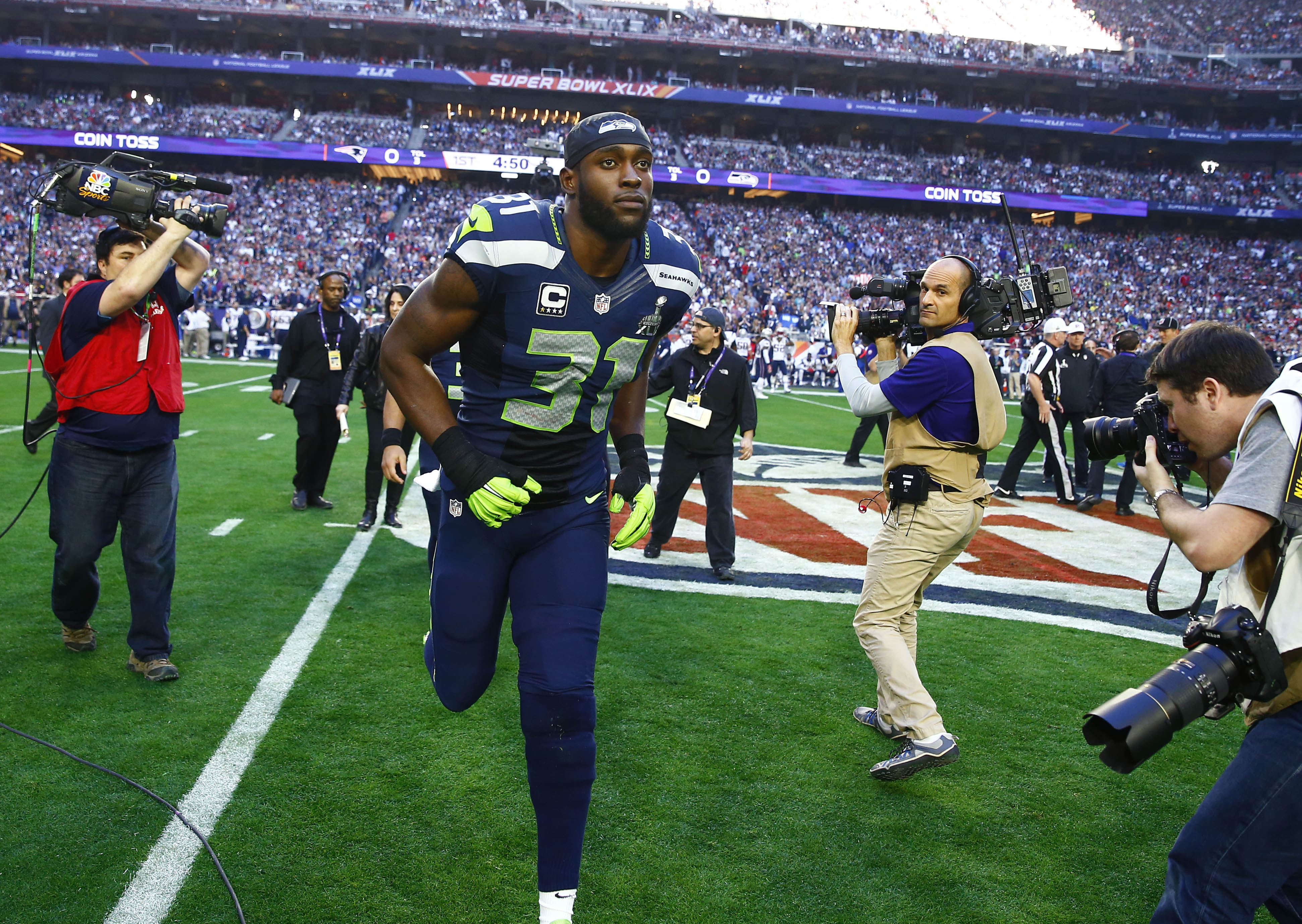 Kam Chancellor's holdout is over as he returns to Seahawks