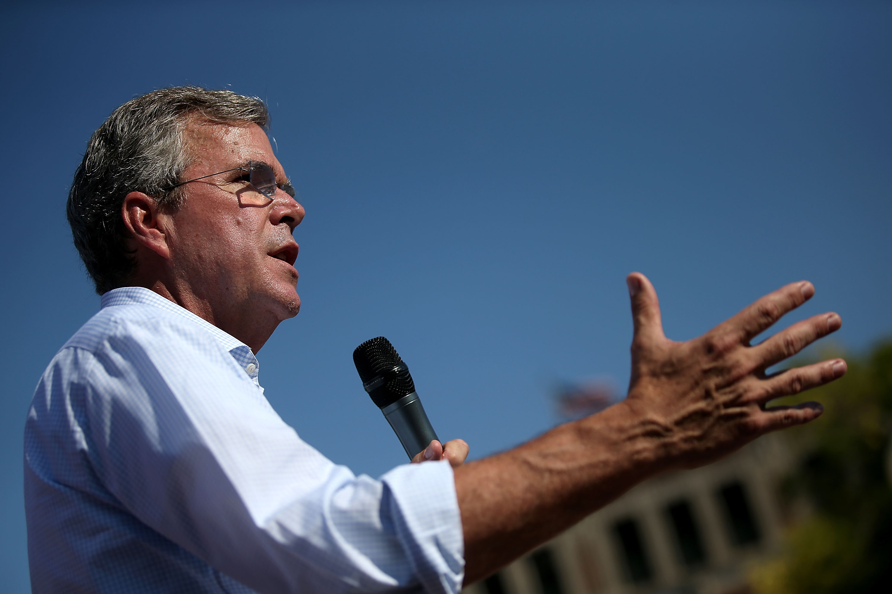 Republican presidential hopeful and former Florida Gov. Jeb Bush speaks to fairgoers during the Iowa State Fair on August 14, 2015, in Des Moines, Iowa.