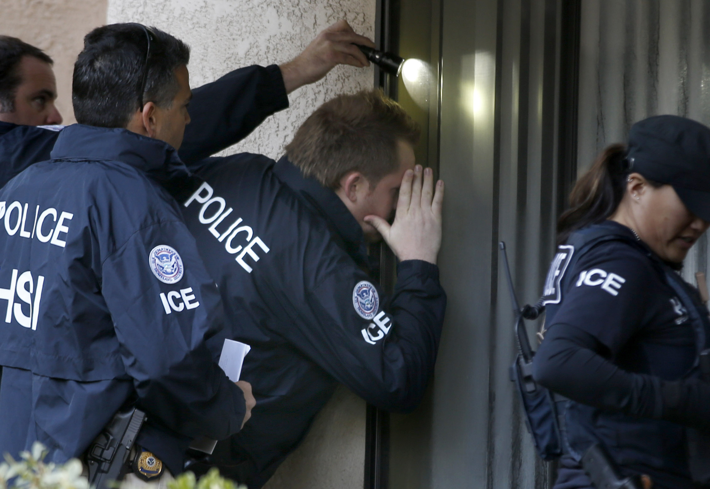 Homeland Security officials on an immigration investigation.