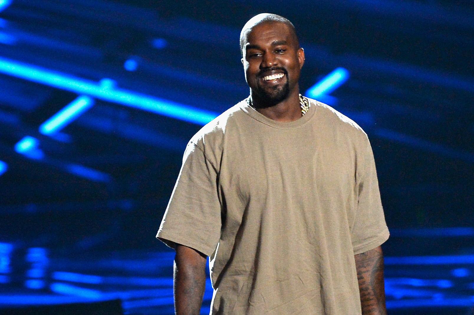 Kanye West accepts his Vanguard Award.