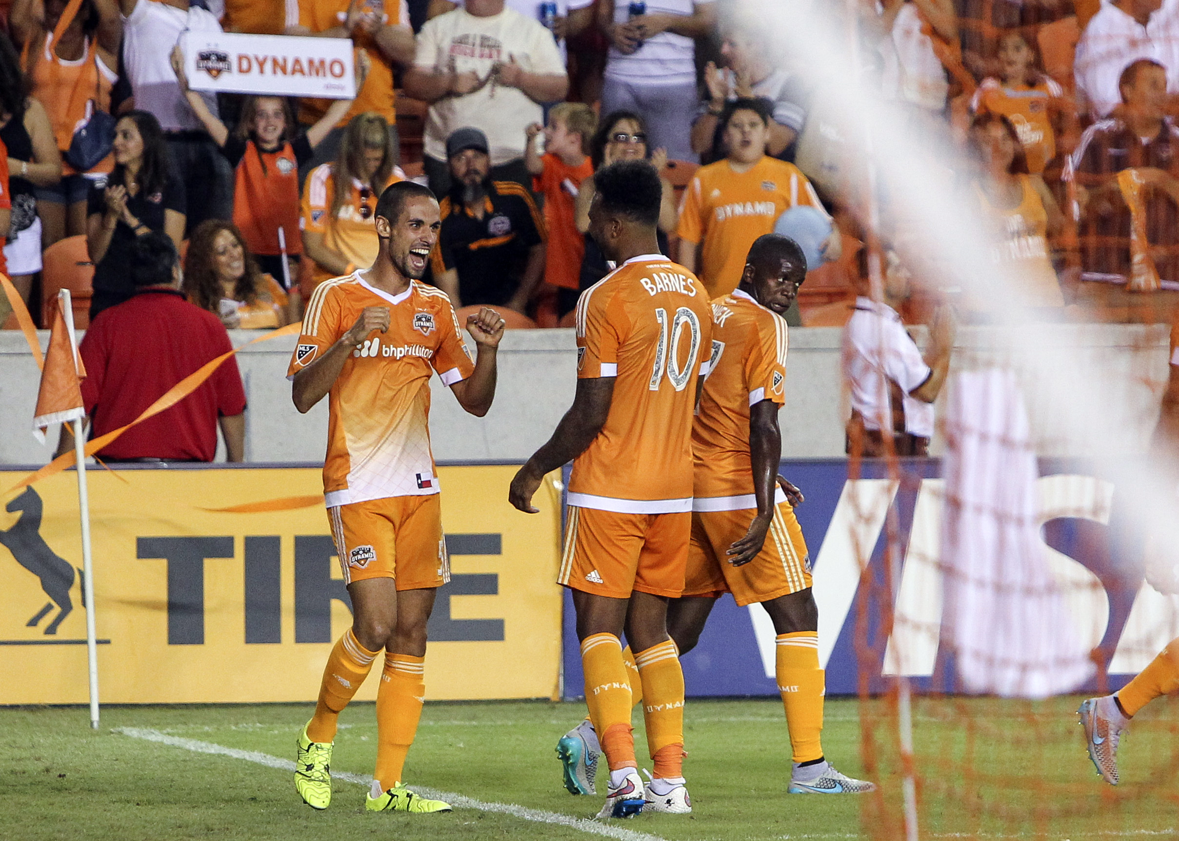 Raul Rodriguez (left) finished off the Dynamo win over Vancouver in style.