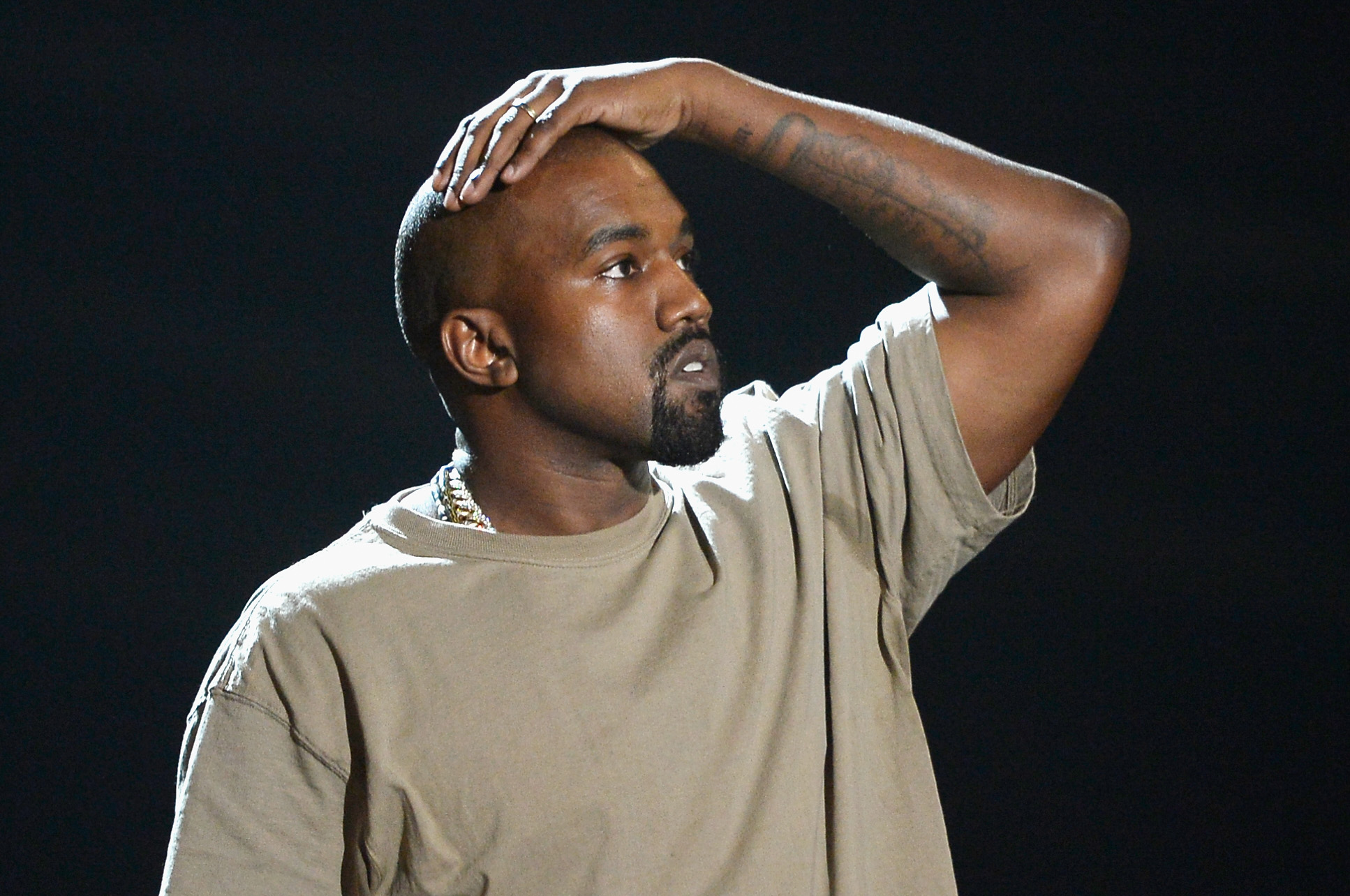 Kanye West pauses for a moment in his VMA Vanguard Award acceptance speech.