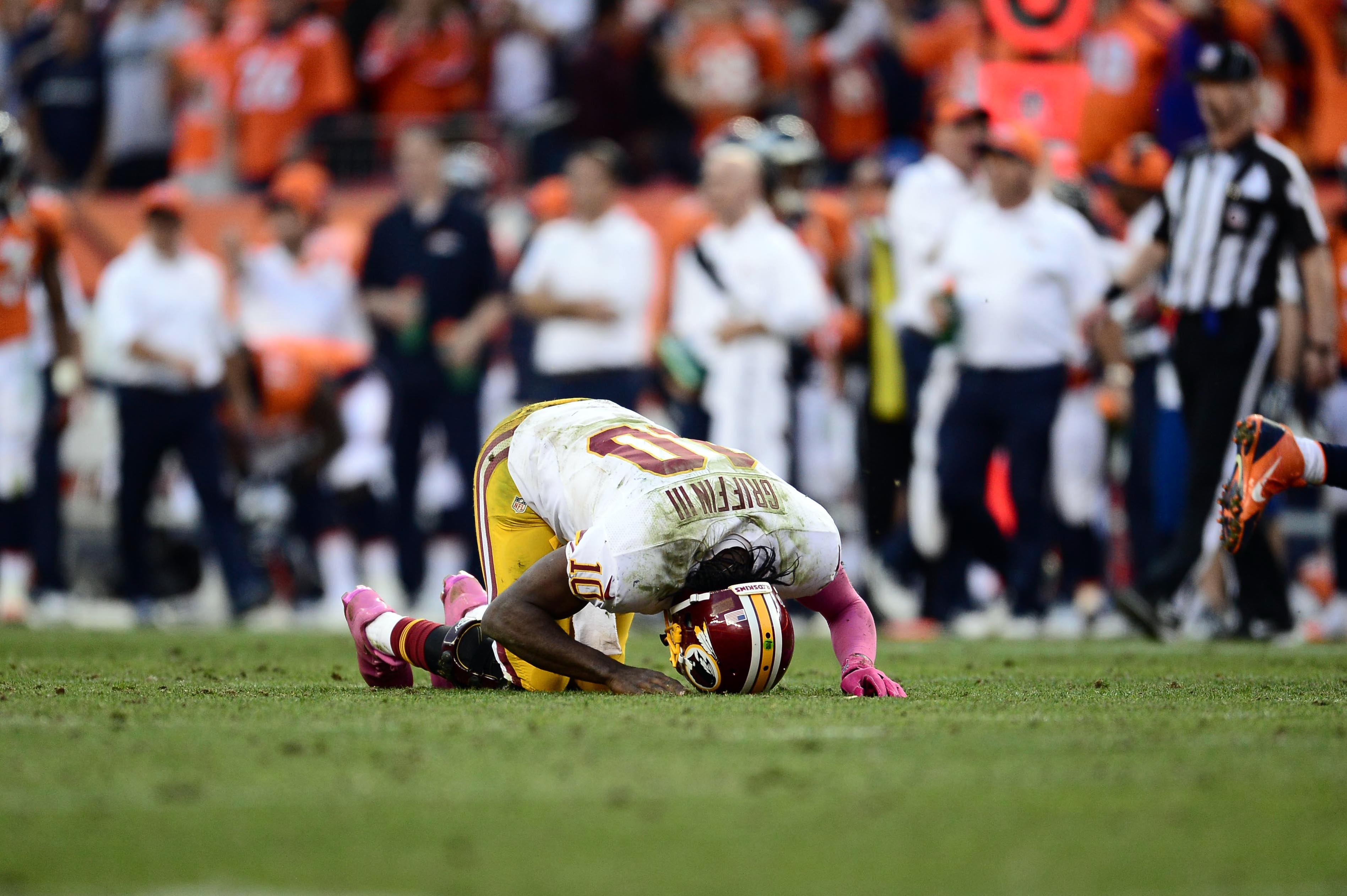 NFL neurologist who switched RG3 diagnosis resigns, per report