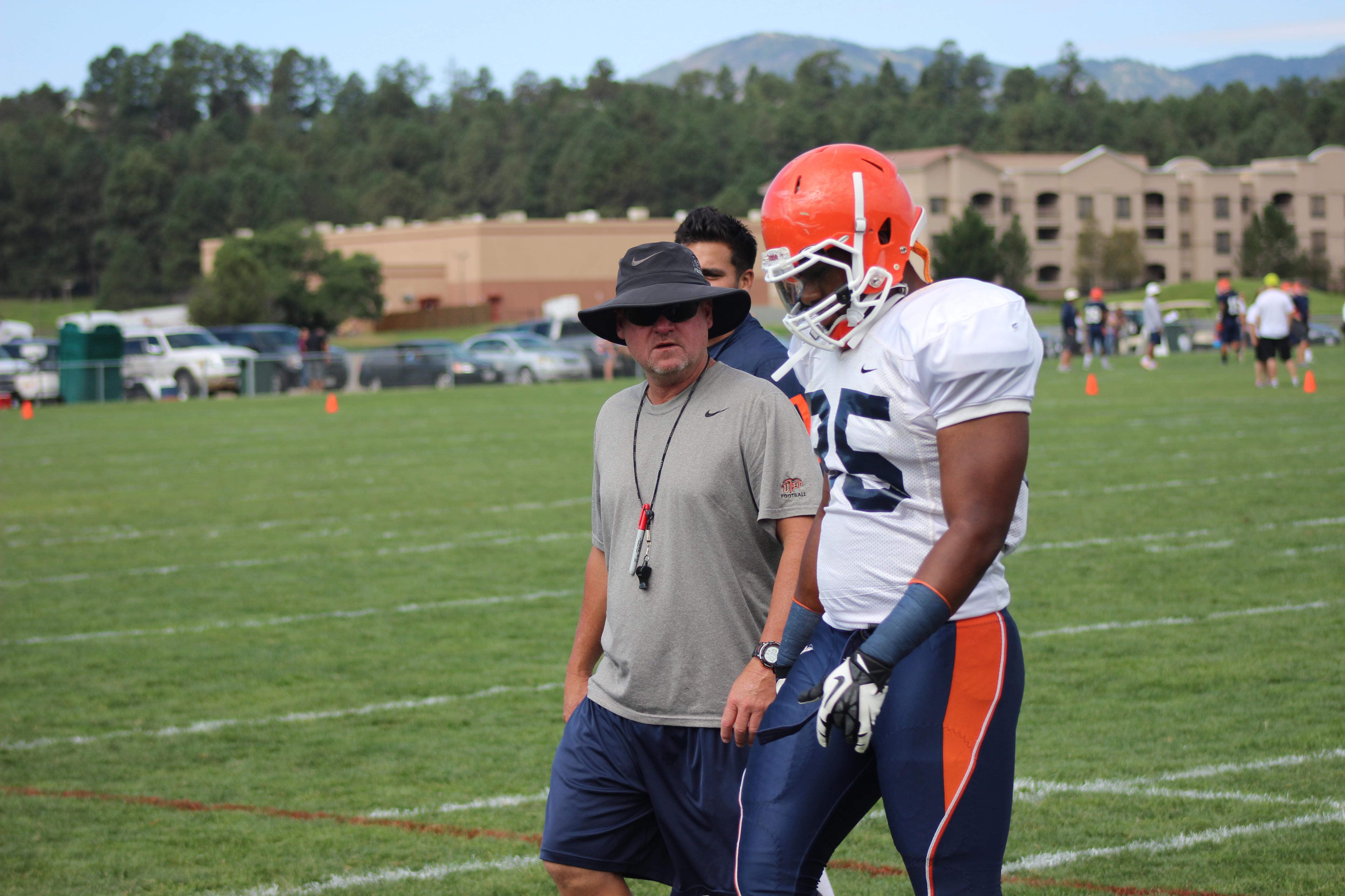 Defensive coordinator Scott Stoker gets another defensive back to work with