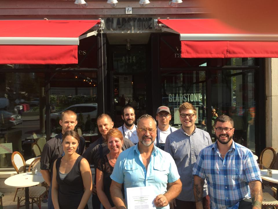 Le Gladstone's team recently posed with a certificate from TripAdvisor