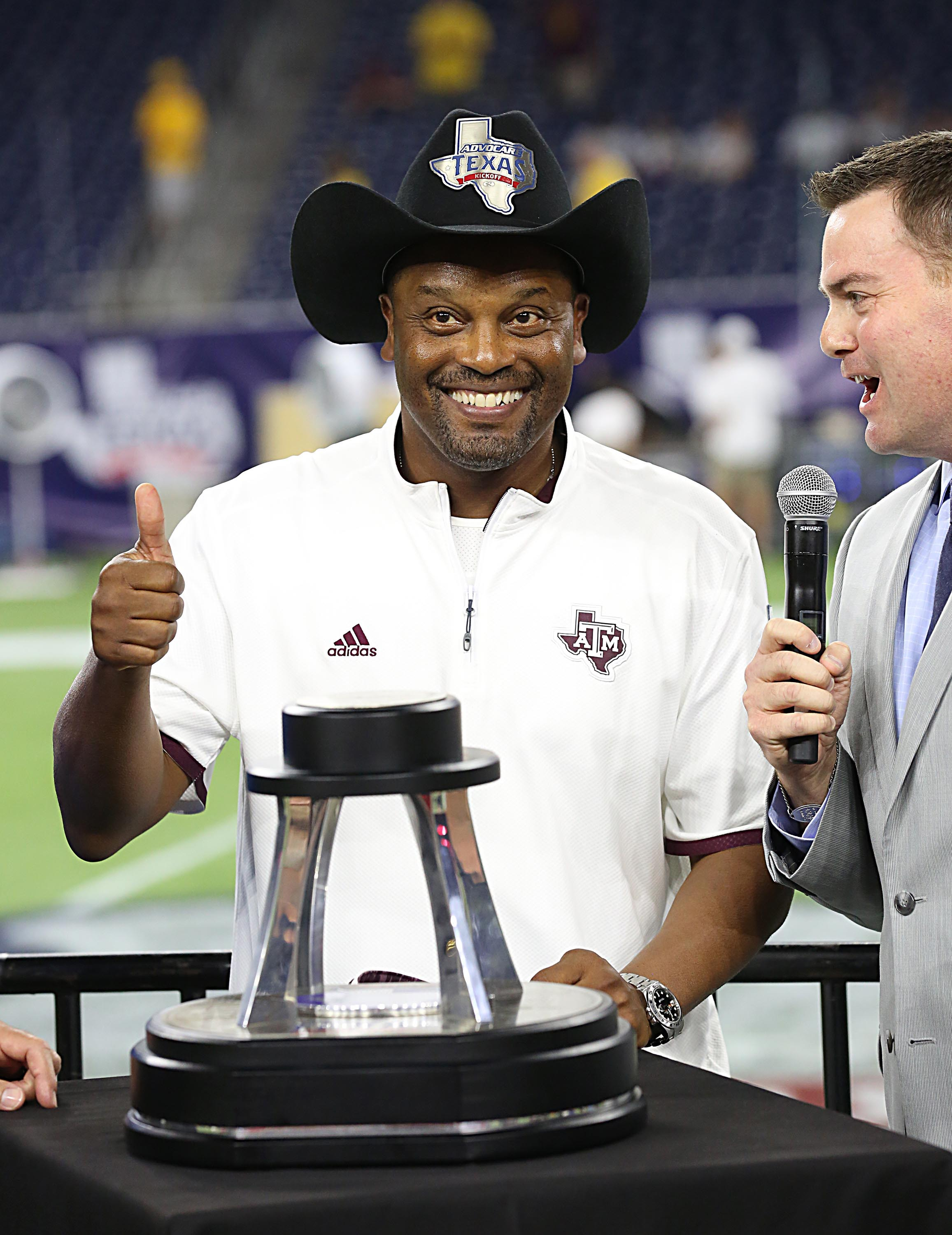 Kevin Sumlin glances at all the recruits sliding into his DMs.