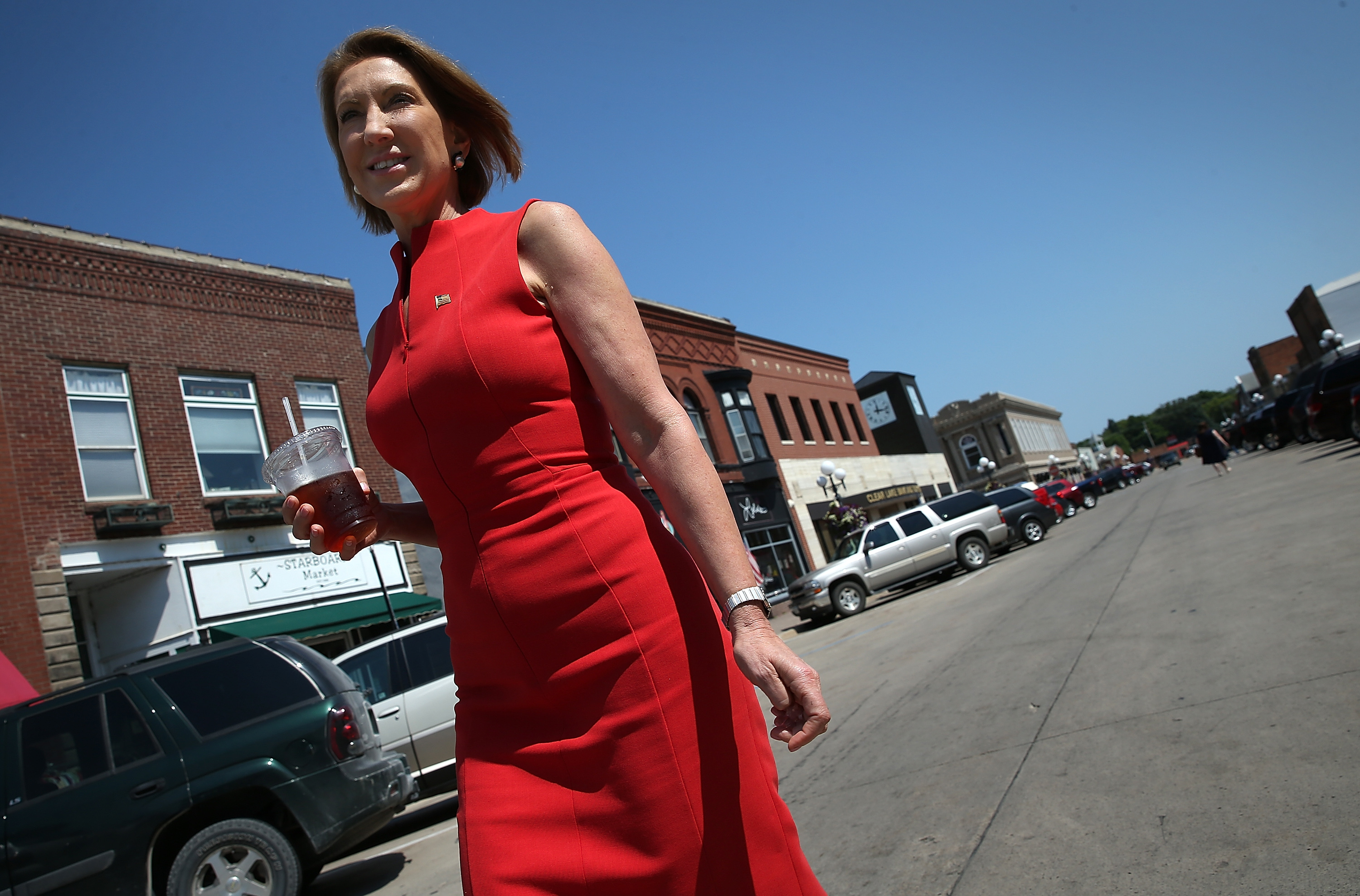 Republican presidential candidate Carly Fiorina walks down Main Street after having lunch at the Starboard Market August 14, 2015, in Clear Lake, Iowa.