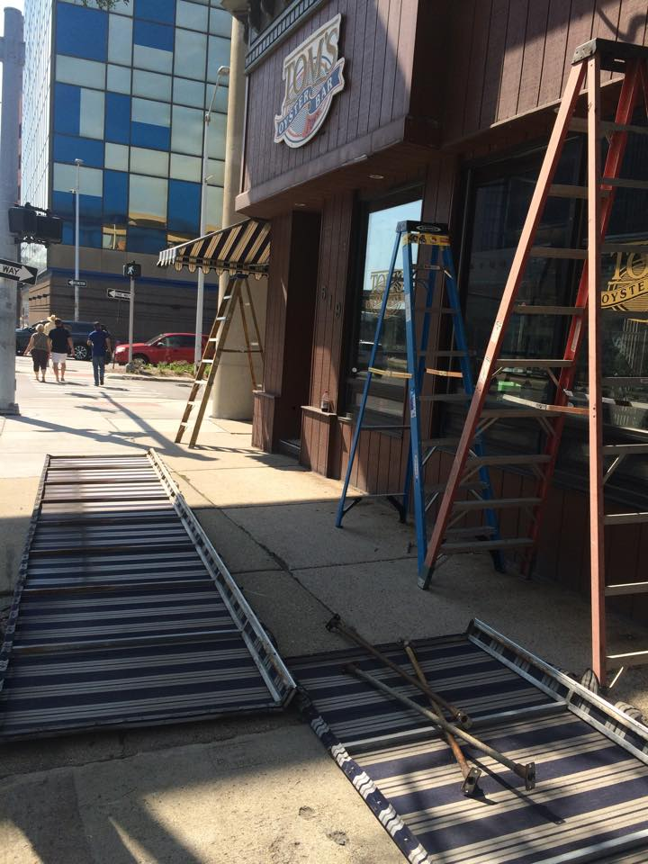 The awnings and signs from Tom's Oyster Bar have been removed to make way for Briggs Detroit.