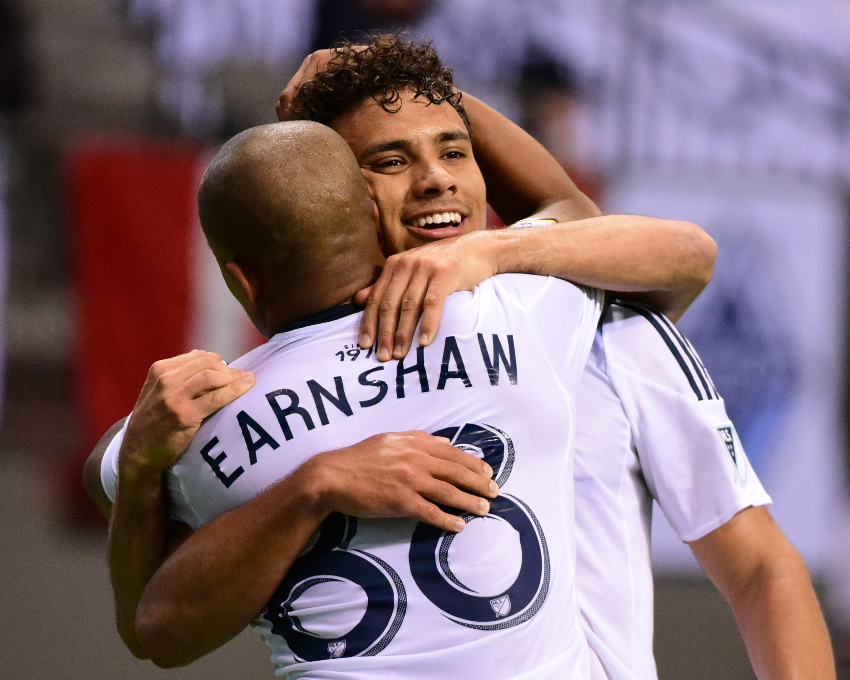 Kianz Froese (facing camera) celebrates scoring against CD Olimpia with teammate Robert Earnshaw.  The Whitecaps' victory moves them into a tie for first place in Group F with the Seattle Sounders.