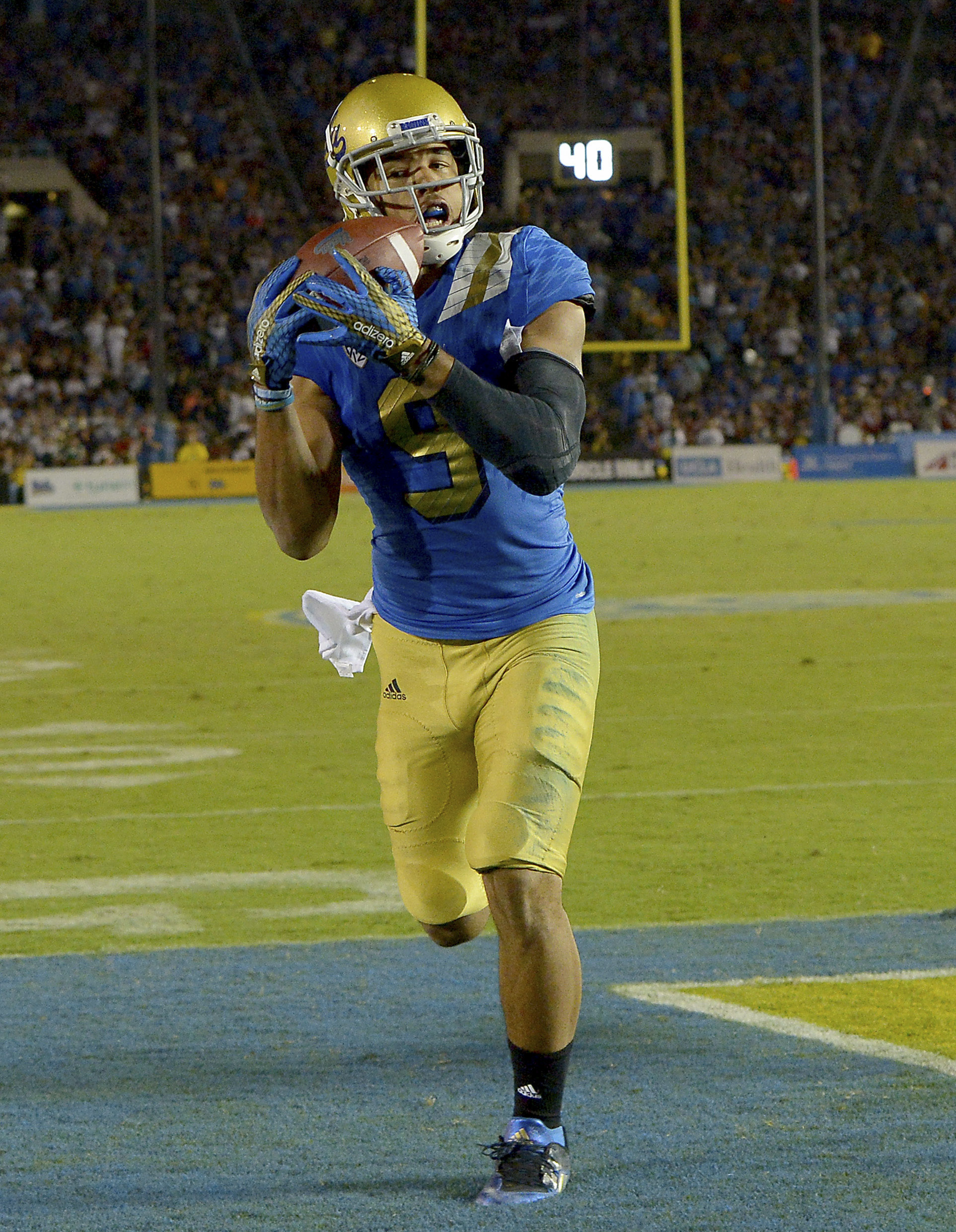 Jordan Payton's 4th quarter TD catch not only helped get the Bruins past BYU but also helped them move up one spot in each poll.