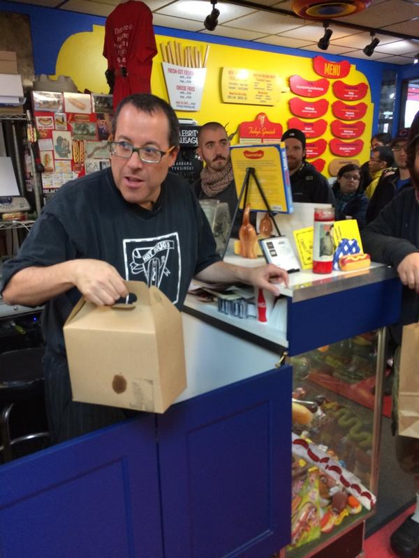 Doug Sohn accepting a Honey Butter Fried Chicken delivery on the day Hot Doug's closed.