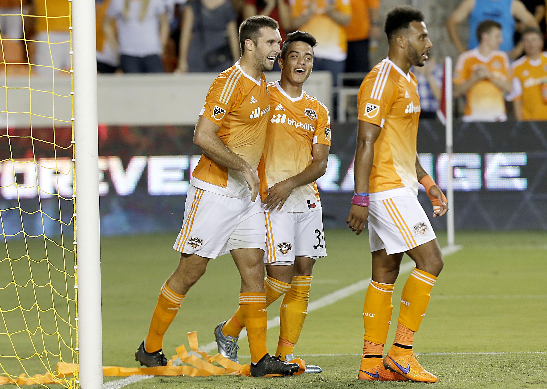 Will Bruin (left) Leonel Miranda (center) and Giles Barnes combined to score the Dynamo's opening goal Saturday.