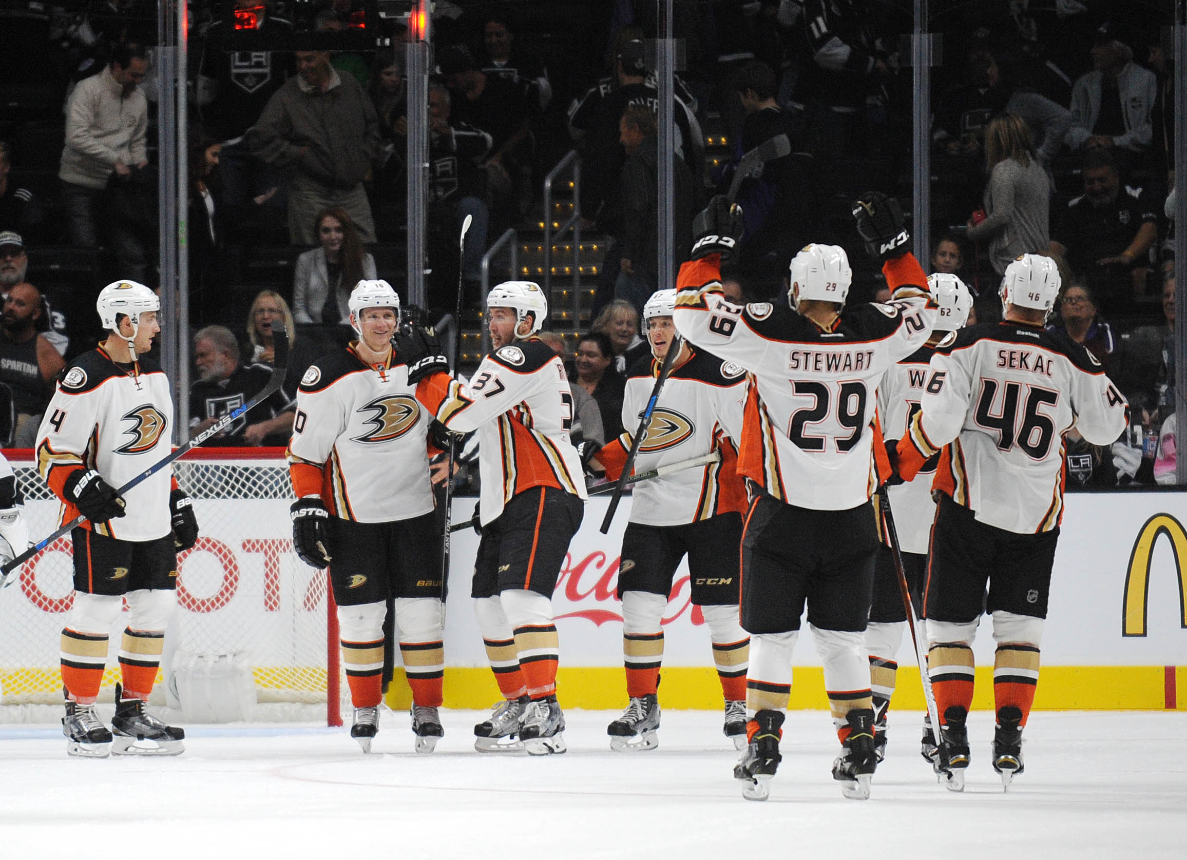 The Ducks celebrate with Corey Perry after he scored the winning goal in overtime at STAPLES Center.