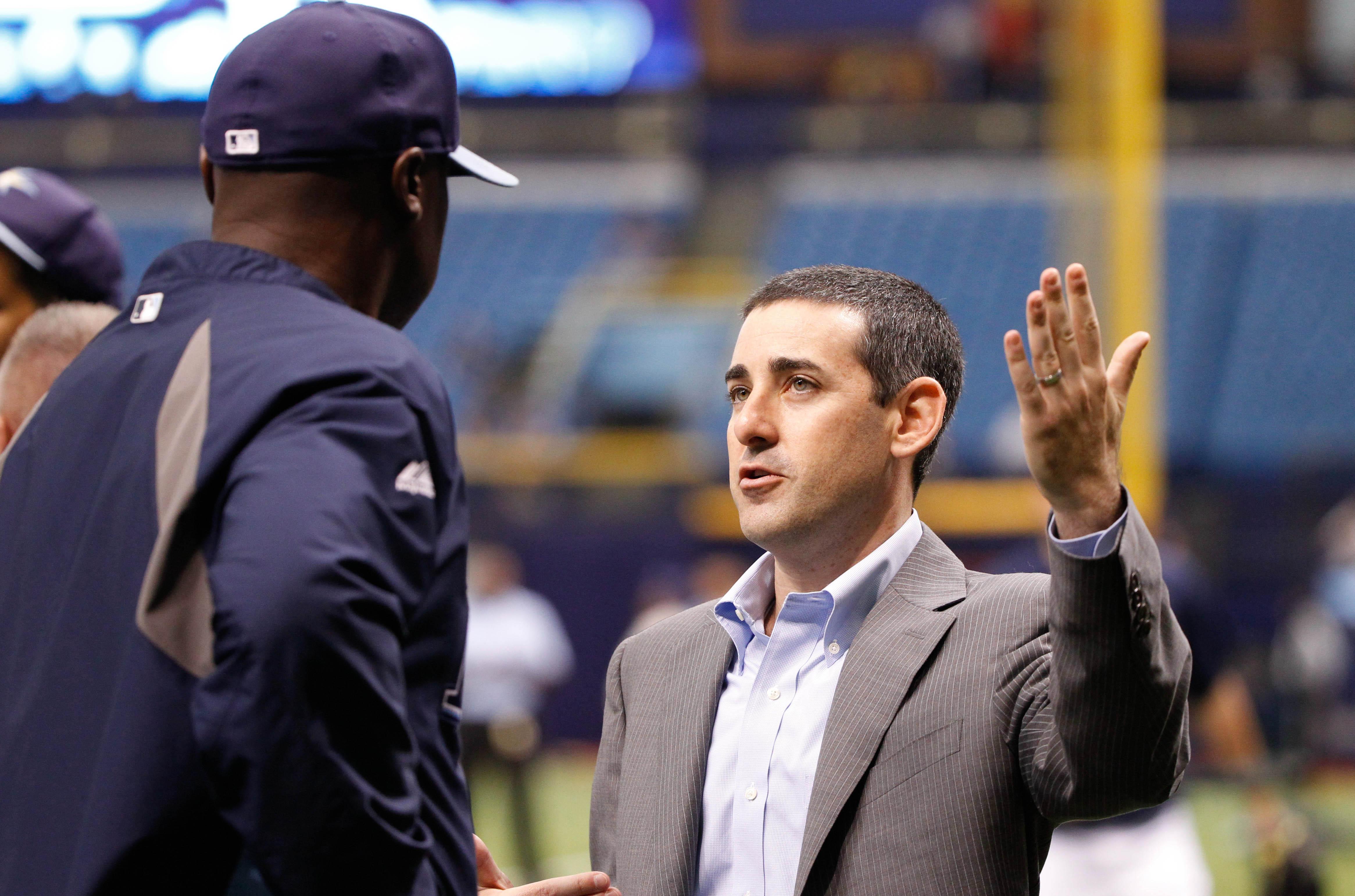 Matt Silverman talks with former first base coach George Hendrick