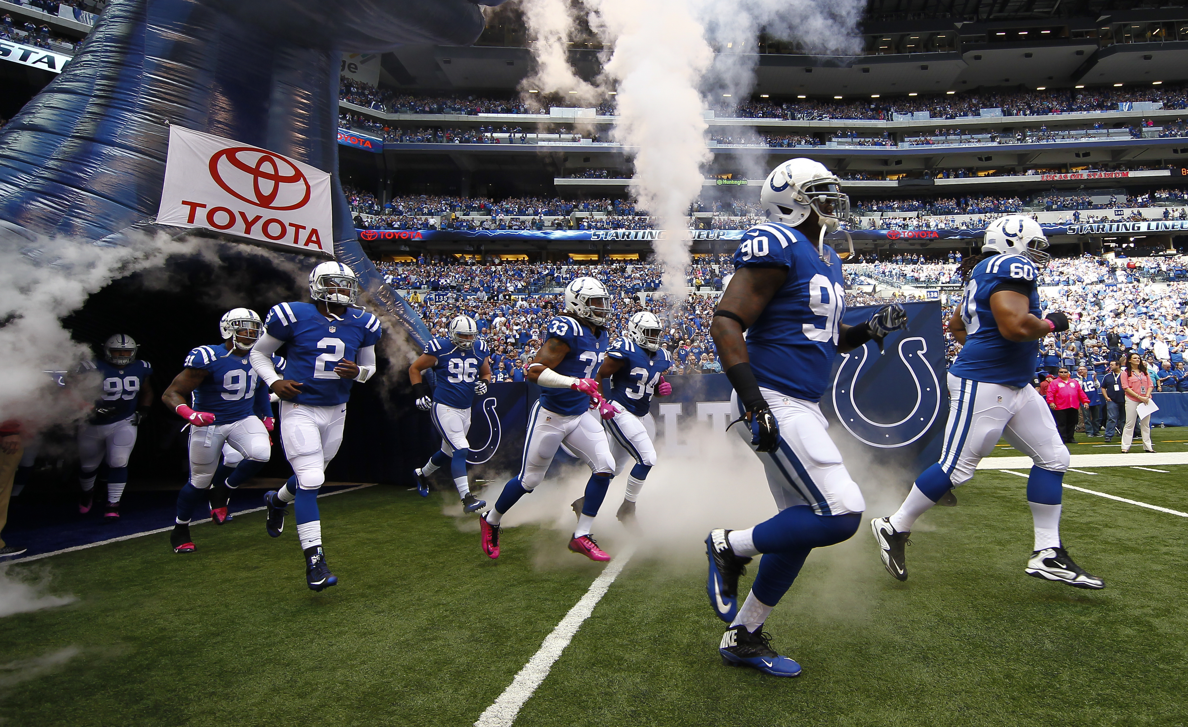 Members of the Indianapolis Colts take the field before the game against the Jacksonville Jaguars at Lucas Oil Stadium on October 4, 2015, in Indianapolis, Indiana.