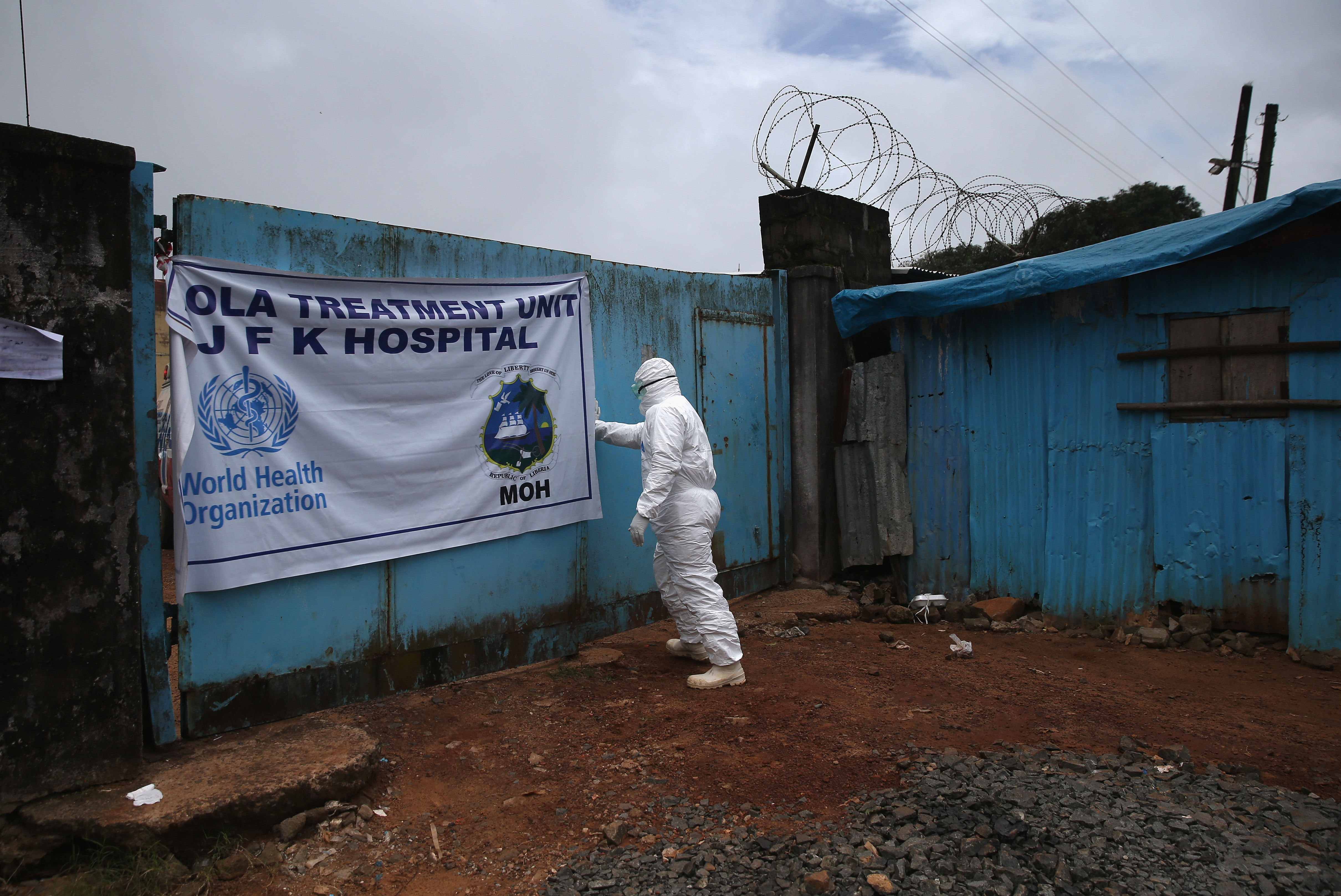 A member of a burial team prepares to collect Ebola victims from a treatment center on October 2, 2014, in Monrovia, Liberia.