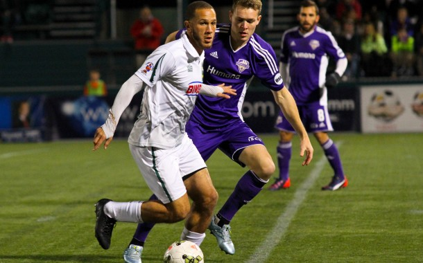 Louisville's Magnus Rasmussen defends against a Rochester Rhino in the USL Eastern Conference Final.