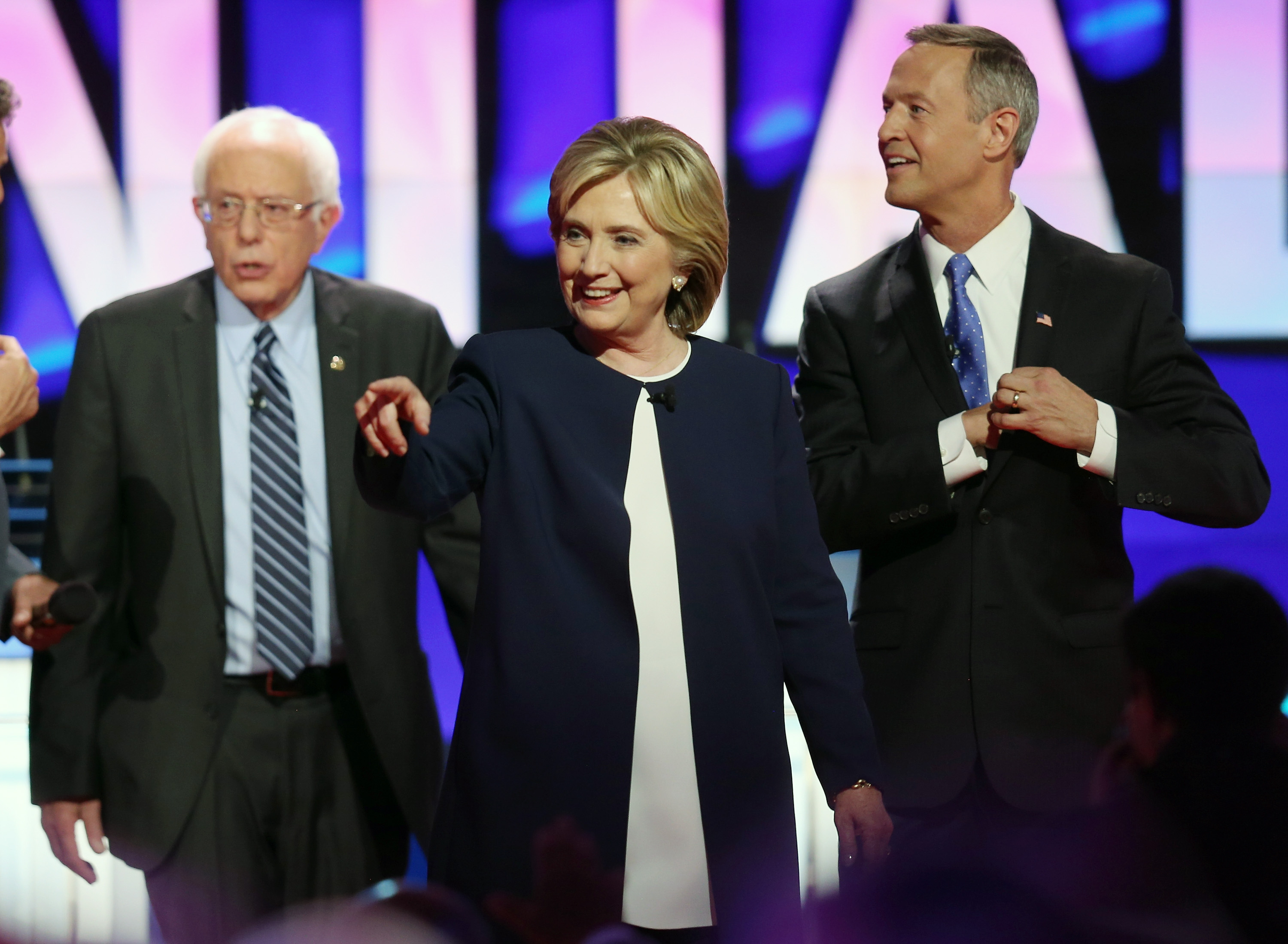 Democratic presidential candidates Sen. Bernie Sanders (I-VT) Hillary Clinton, and Martin O'Malley walk on the stage at the end of a presidential debate sponsored by CNN and Facebook at Wynn Las Vegas on October 13, 2015, in Las Vegas, Nevada.